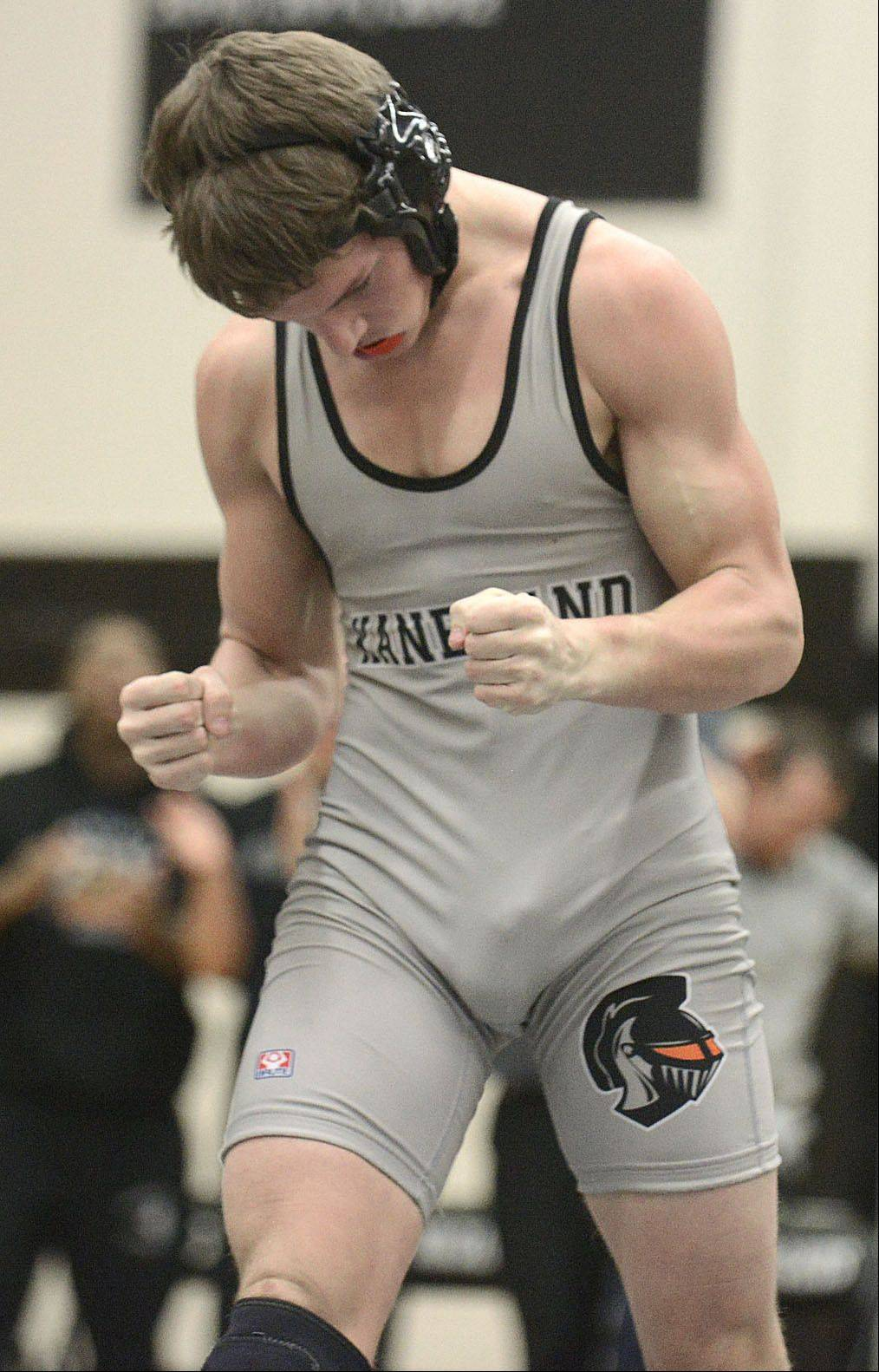 Kaneland's Dane Goodenough celebrates his win in the 138 pound match over DeKalb's Jackson Montgomery on Thursday, December 12.