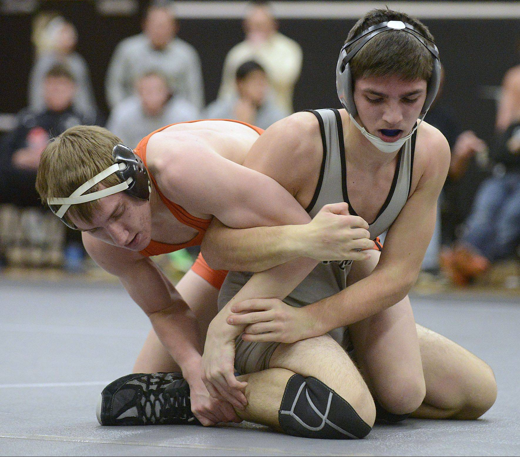 Kaneland's Riley Vanik, right, battles DeKalb's Brad Green at 145 pounds.