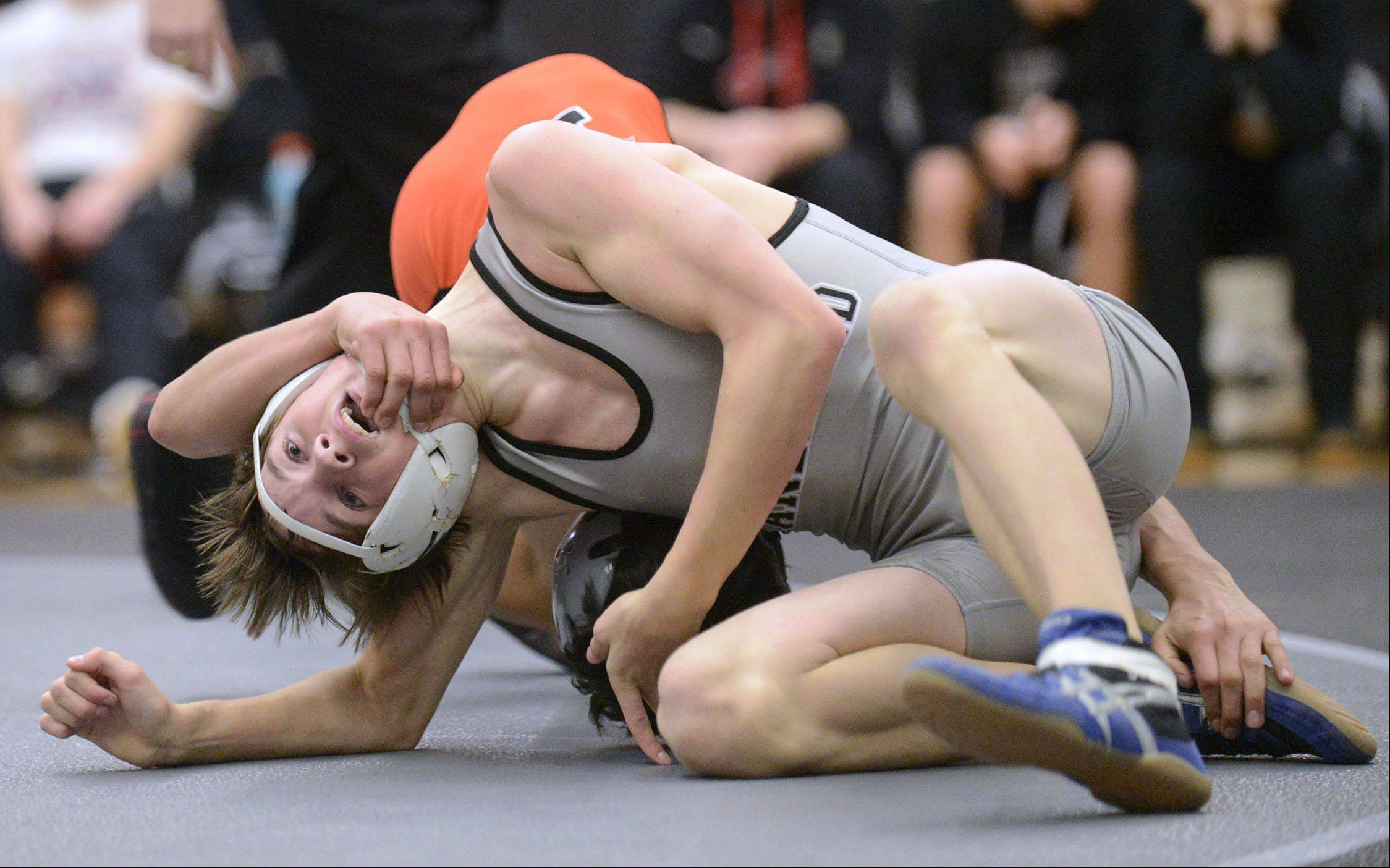Kaneland's Adam Mish and DeKalb's Ulises Jacobo in the 113 pound match on Thursday, December 12. Jacobo took the win.