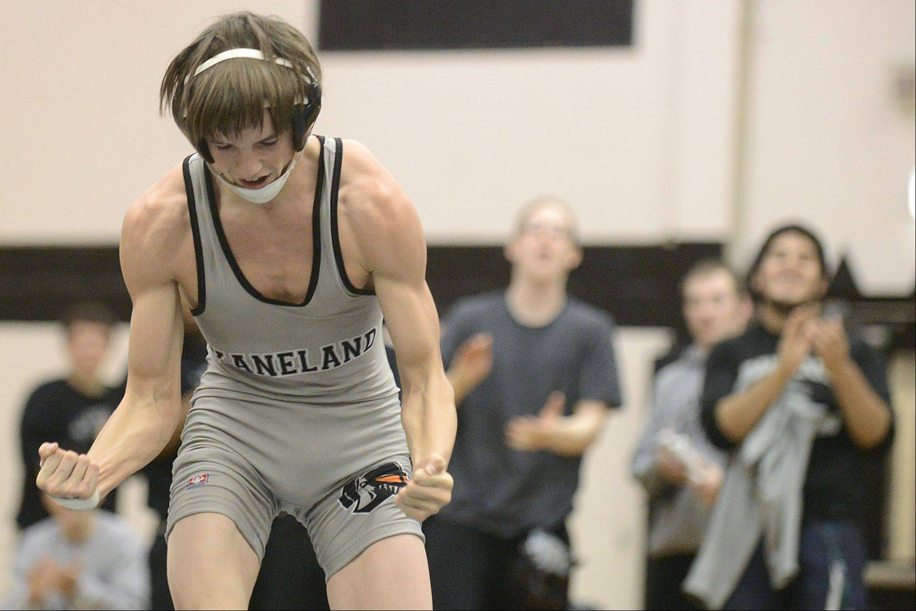 Kaneland's Nick Mish celebrates his win over DeKalb's Alex Irick in the 106 pound match on Thursday, December 12.