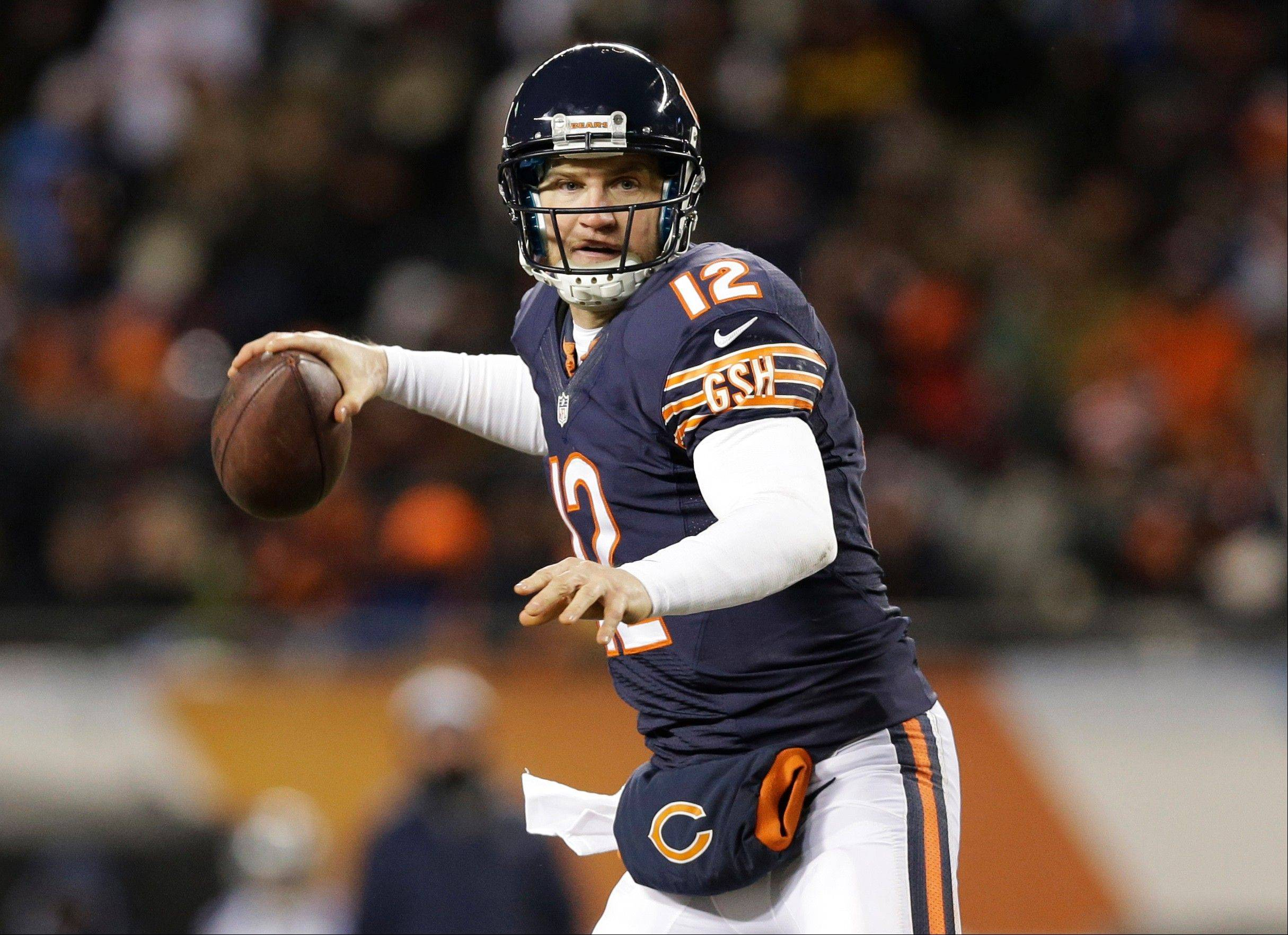 Bears quarterback Josh McCown (12) prepares to pass against the Dallas Cowboys during the first half of an NFL football game, Monday, Dec. 9, 2013, in Chicago.