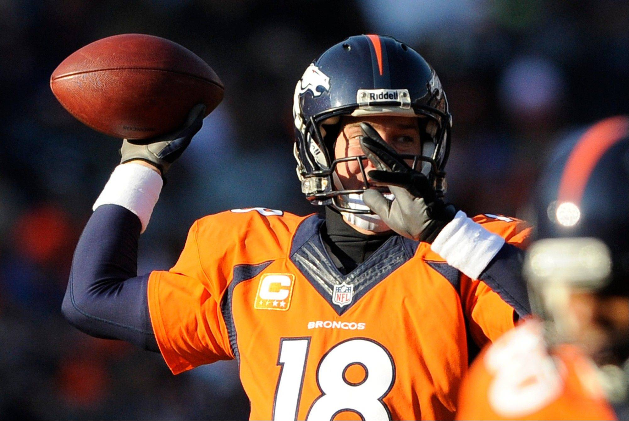 Denver Broncos quarterback Peyton Manning throws against the Tennessee Titans during the first half of an NFL football game on Sunday, Dec. 8, 2013, in Denver.