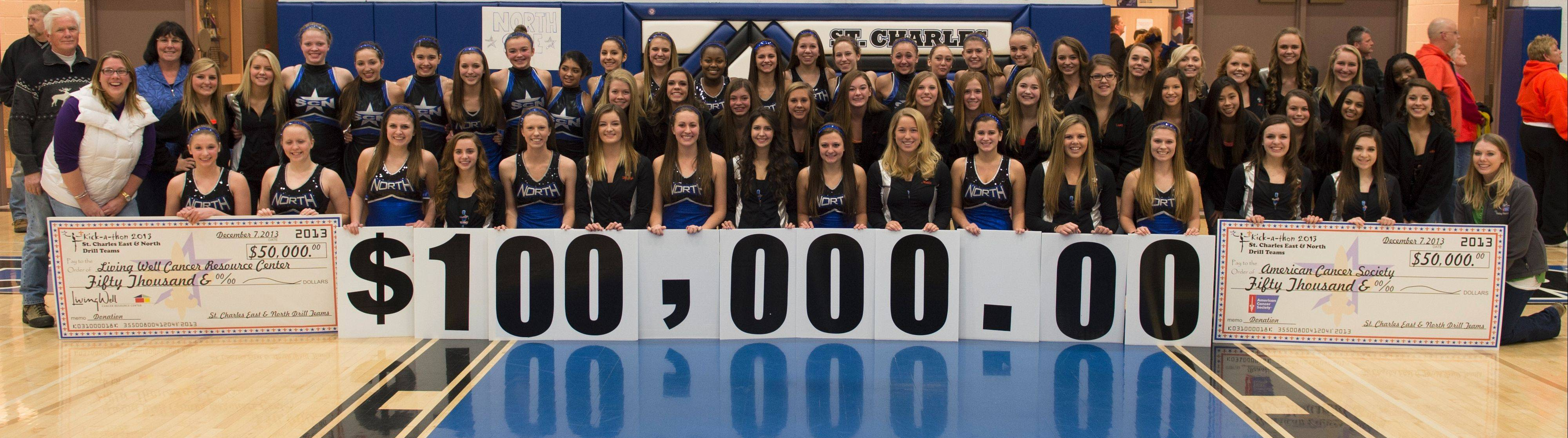 The St. Charles East and St. Charles North Drill Teams, pictured Saturday night before the schools' boys basketball game, raised $100,000 this fall at their annual Kick-A-Thon.