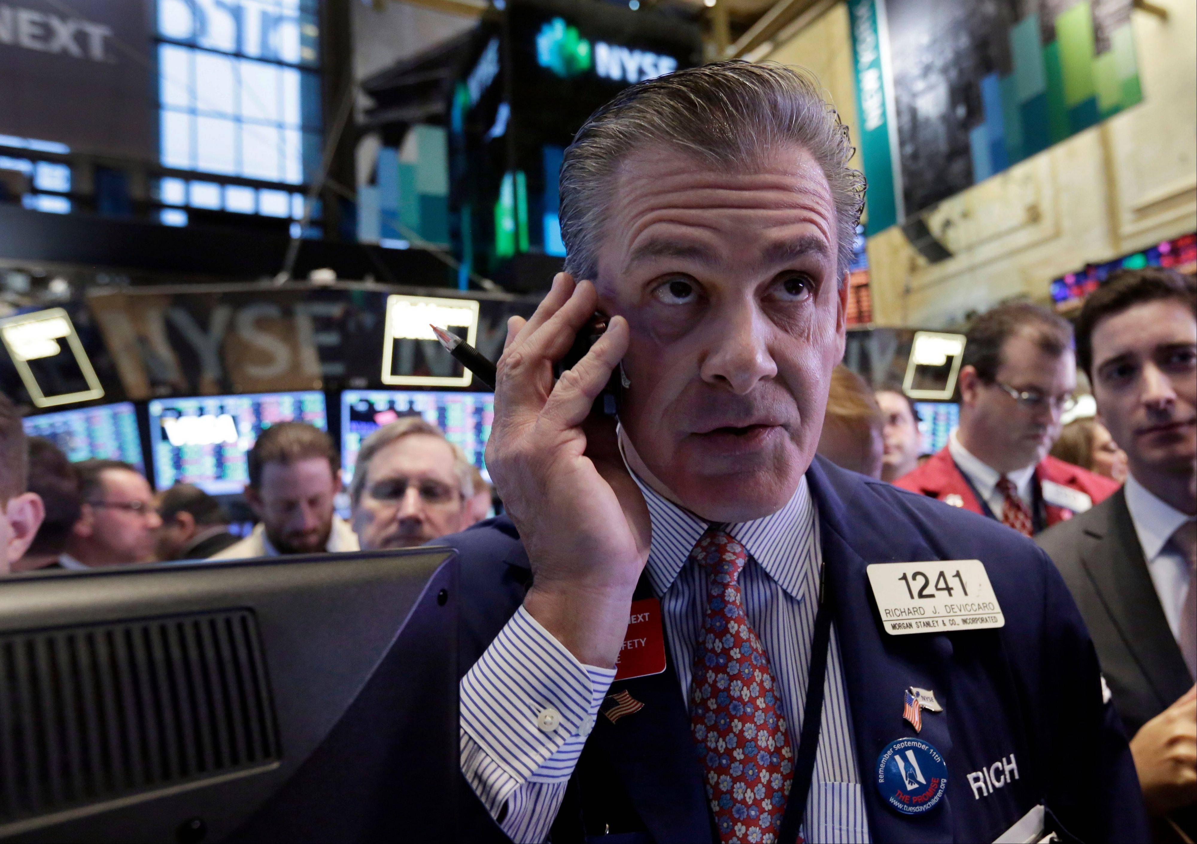 Trader Richard DeViccaro works Thursday on the floor of the New York Stock Exchange. December is shaping up to be a poor month for the stock market. The Dow, S&P and Nasdaq are all down.