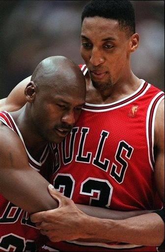 In this June 11, 1997 photo, Chicago Bulls Scottie Pippen, embraces an exhausted Michael Jordan following their 90-88 win in Game 5 of the NBA Finals against the Utah Jazz, in Salt Lake City.