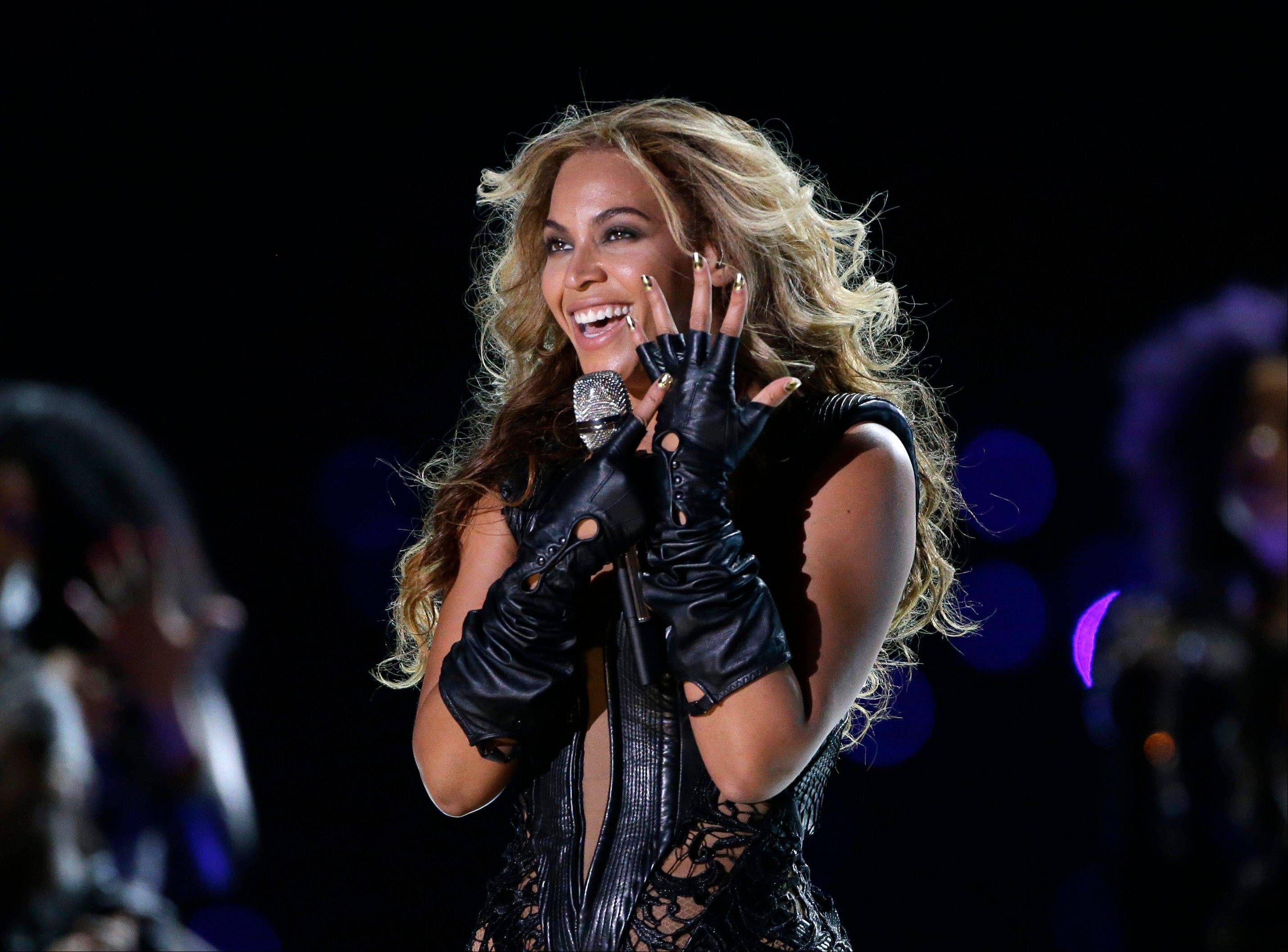 Beyonc� released her fifth self-titled album exclusively on iTunes early Friday.