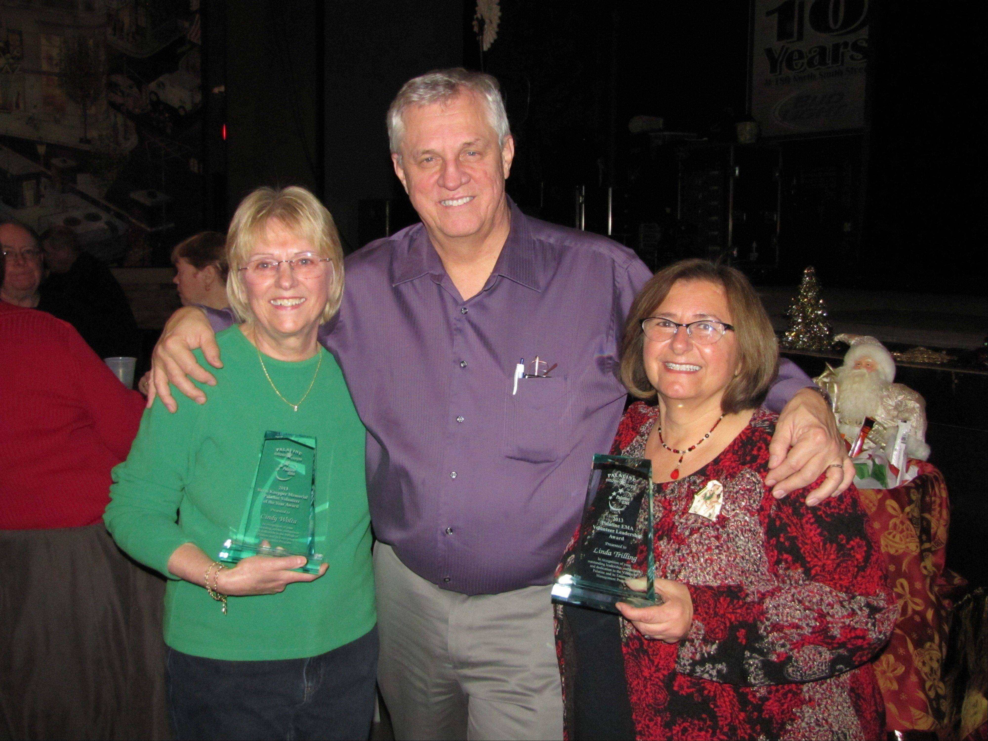 Cindy Wolta, left, is Palatine Emergency Management Agency Volunteer of the Year. Tom Smith, middle, agency coordinator, recognized Linda Trilling, right, disaster services coordinator from HandsOn Suburban Chicago, for her support for the Palatine program.