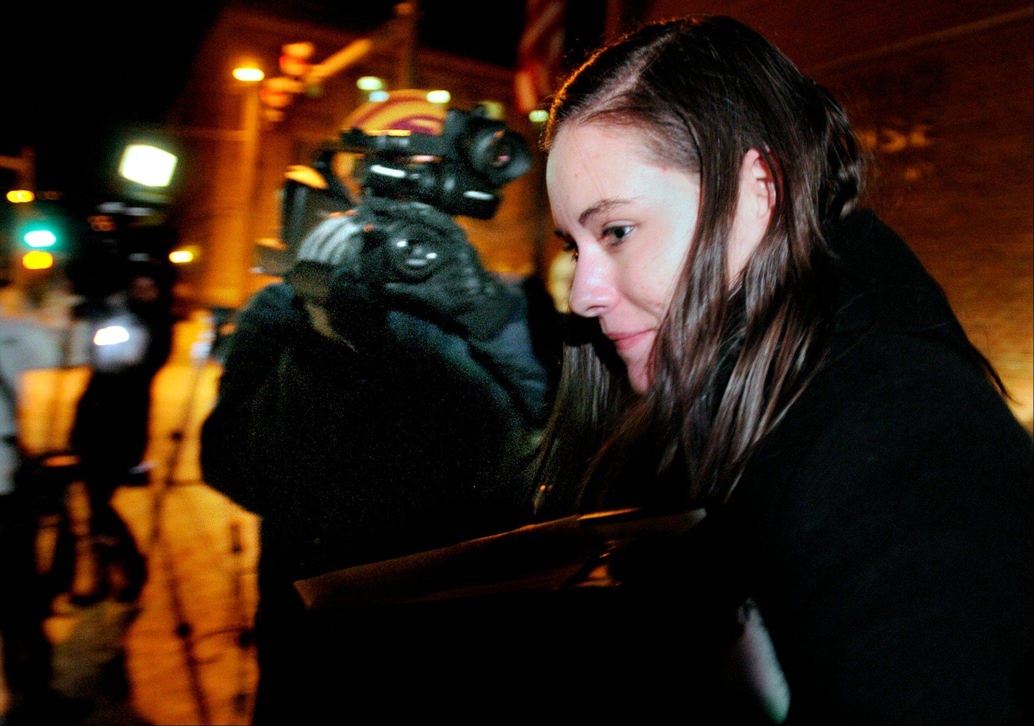 Jordan Graham leaves the Federal Courthouse in Missoula, Mont., Monday, Dec. 9, 2013 after the first day of her murder trial. In a surprising end to her murder trial, Graham, 22, accepted a last-minute deal with prosecutors to plead guilty to second-degree murder in the death of Cody Johnson, her husband of eight days, and admitted to pushing him off a cliff in Glacier National Park on July 7.