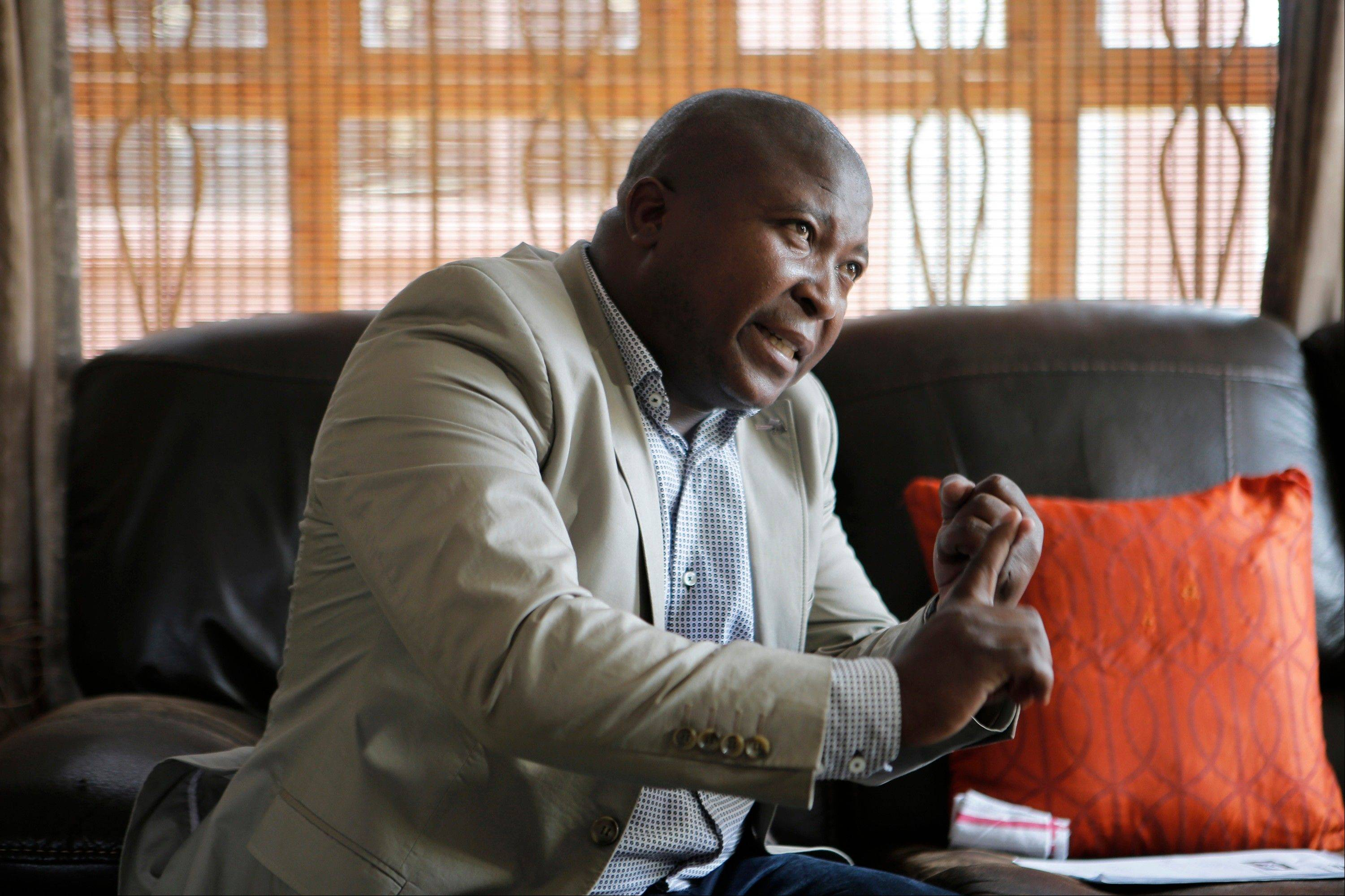 Thamsanqa Jantjie gestures at his home during an interview with The Associated Press in Johannesburg, South Africa, Thursday, Dec. 12, 2013. Jantjie, the man accused of faking sign interpretation next to world leaders at Nelson Mandela�s memorial, told a local newspaper that he was hallucinating and hearing voices.