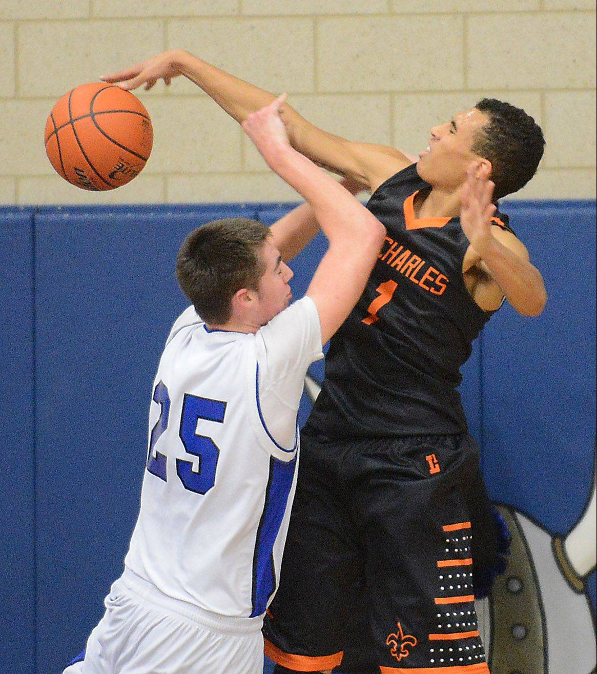 St. Charles East�s AJ Washington blocks a shot by Geneva�s Nate Navigato.