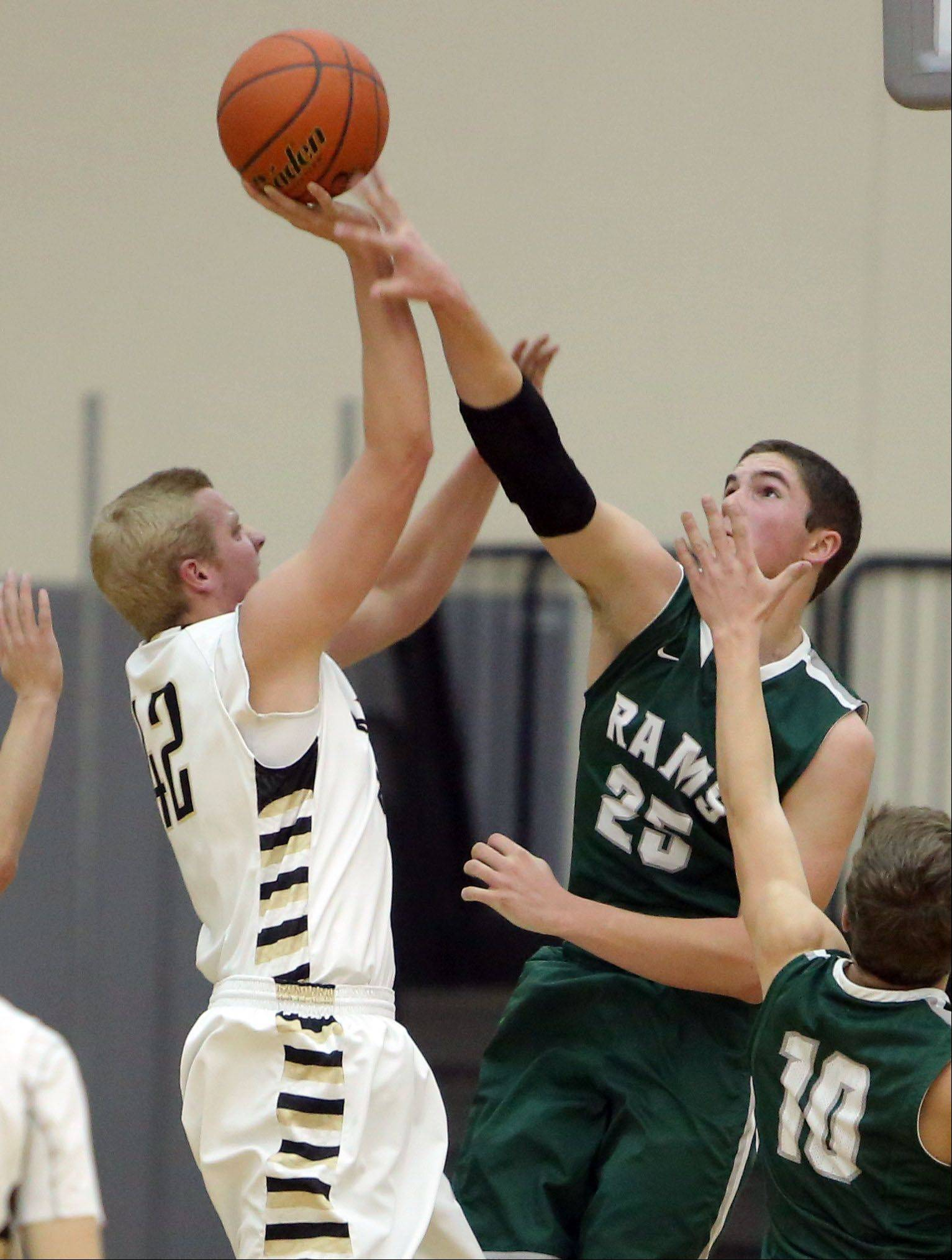 Grayslake Central�s Alex Lennartz, right blocks the shot of Grayslake North�s Nate Dodge on Friday night at Grayslake North.