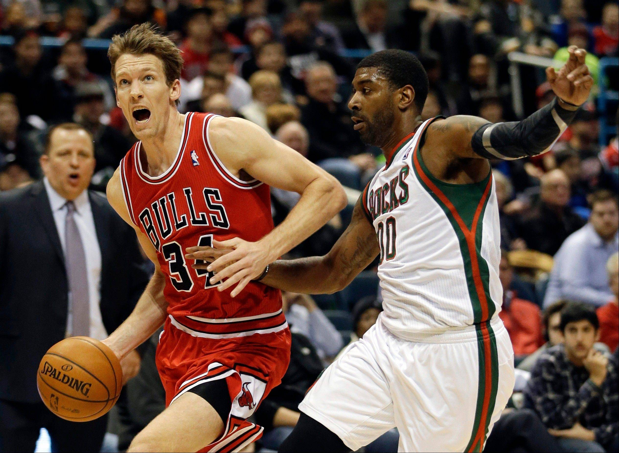Chicago Bulls� Mike Dunleavy, left, is fouled as he tries to drive past Milwaukee Bucks� O.J. Mayo during the first half of an NBA basketball game Friday in Milwaukee. Dunleavy would hit a late 3 pointer to propel the Bulls over the Bucks for the win.