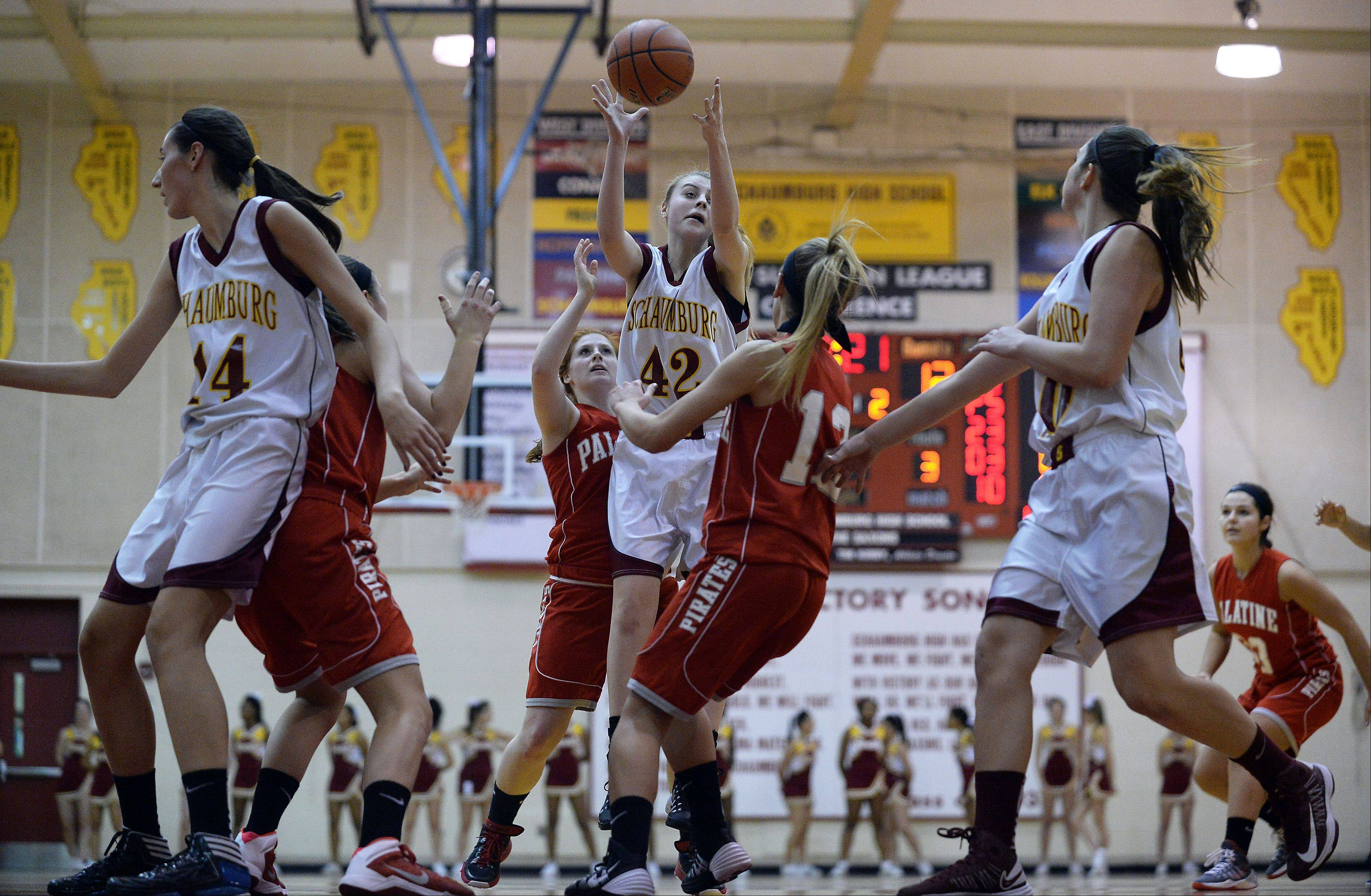 Schaumburg�s Mallory Gerber pulls down a rebound in the first half.