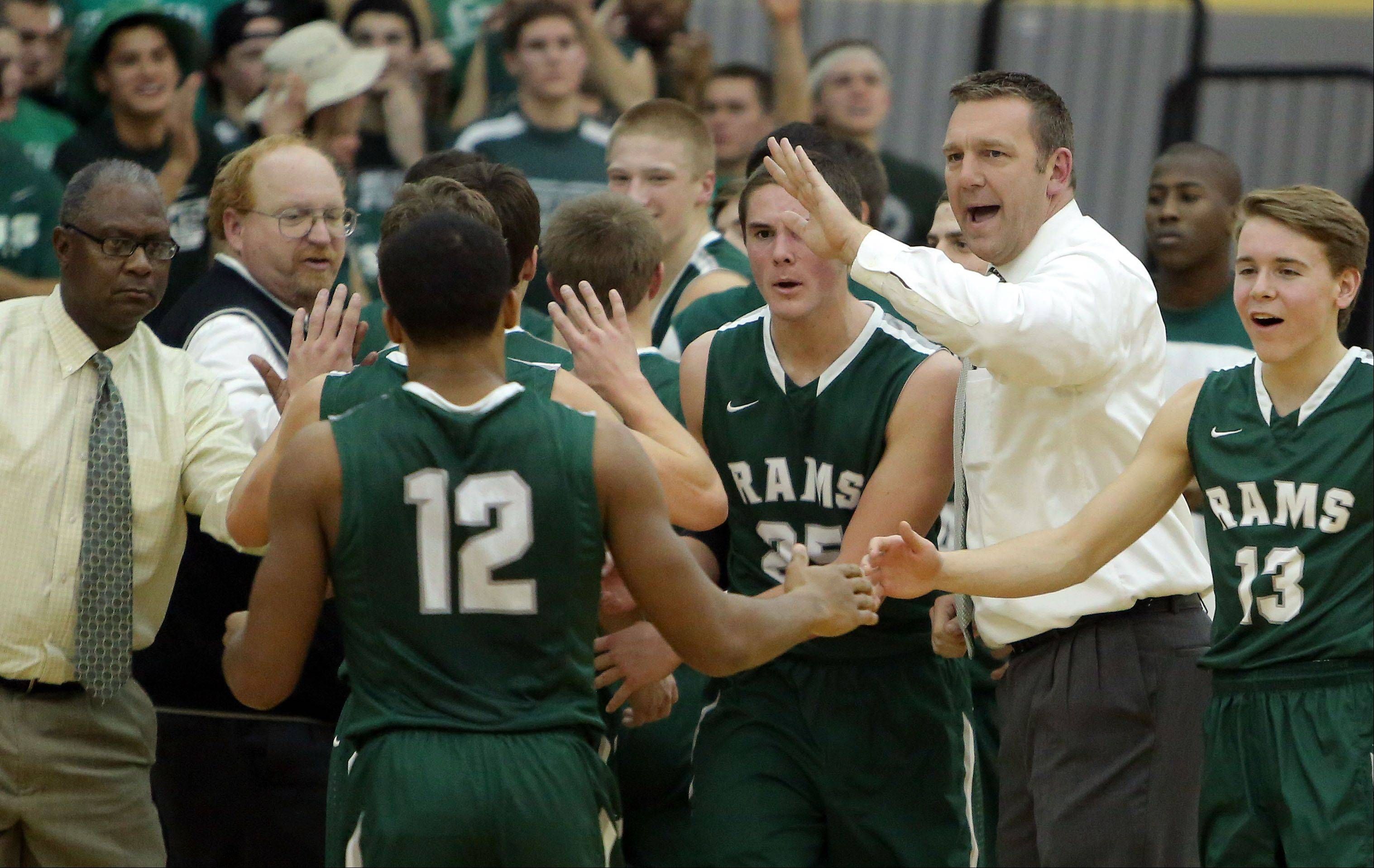 Grayslake Central�s head coach Brian Moe, right, encourages his team.