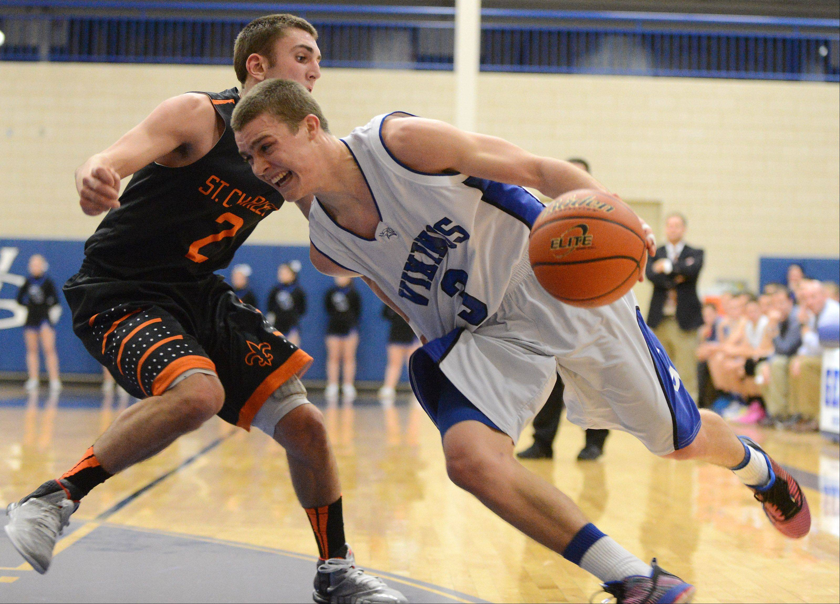 Geneva�s Pace Temple looks for room on the baseline with St. Charles East�s Dom Adduci defending.