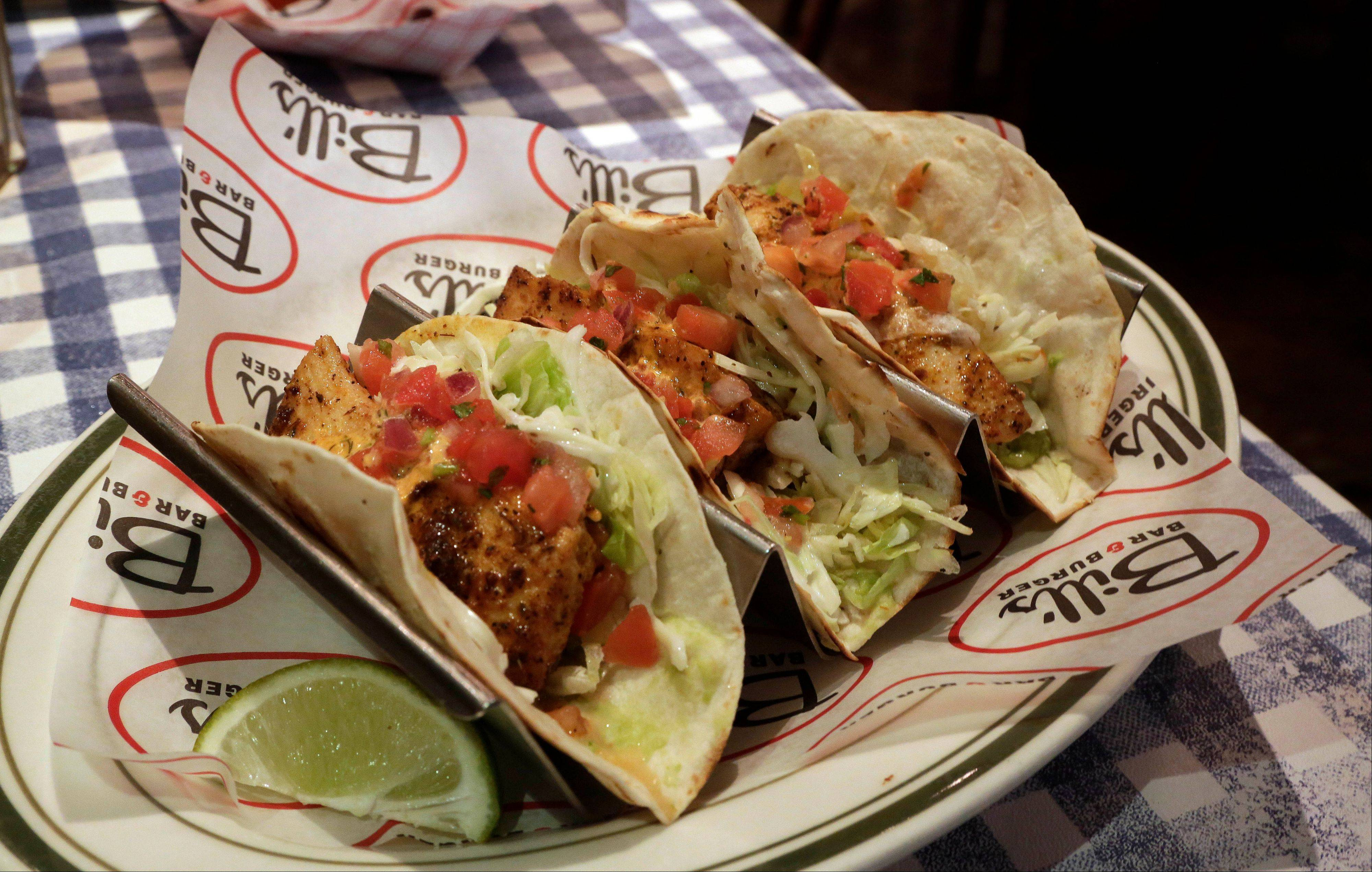 Blackened Mahi fish tacos comes with coleslaw and chipotle aioli at Bill's Bar & Burger in New York's Rockefeller Center.