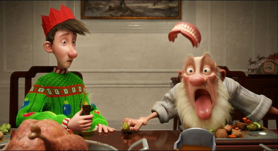 "An aging Santa, right, can't believe his teeth while talking to his son in the animated comedy ""Arthur Christmas."""