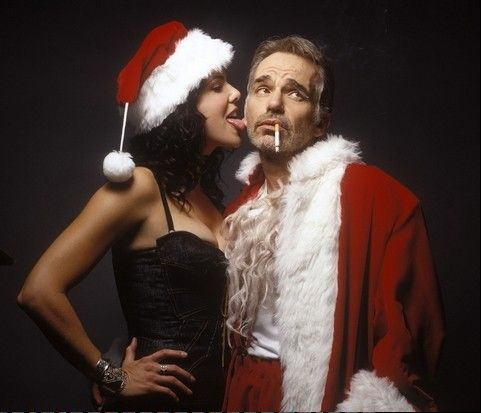 "A con man (Billy Bob Thornton) uses his job as a shopping mall Santa to rob stores in the black comedy ""Bad Santa."""