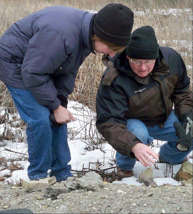 Students Joni Kupar and Tom Priscal examine rocks during a KCCN geology field trip at Campton Hills natural area in St. Charles.
