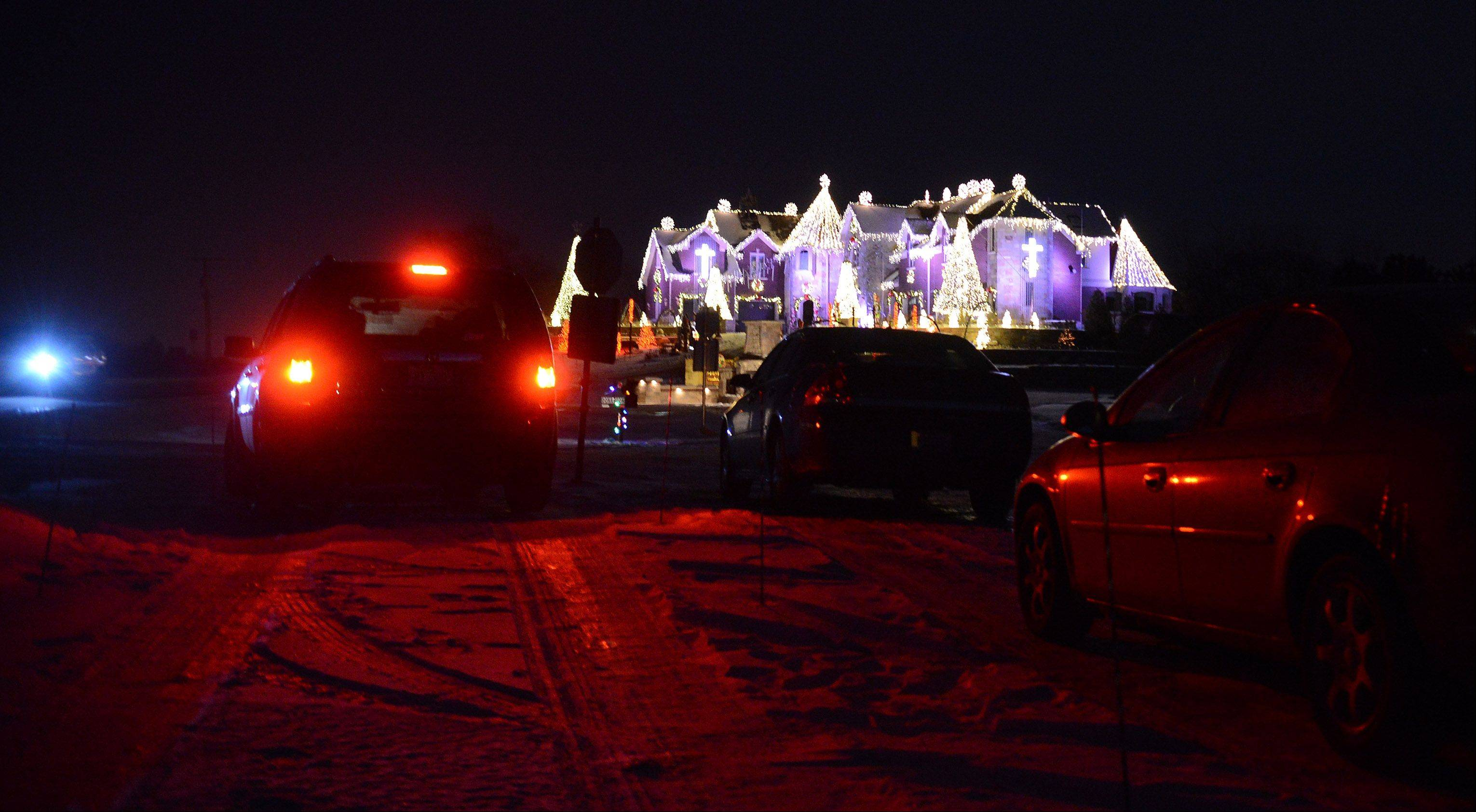 This year, Brian Larson added a paved parking lot, allowing visitors to enjoy the light show at his Elburn home.