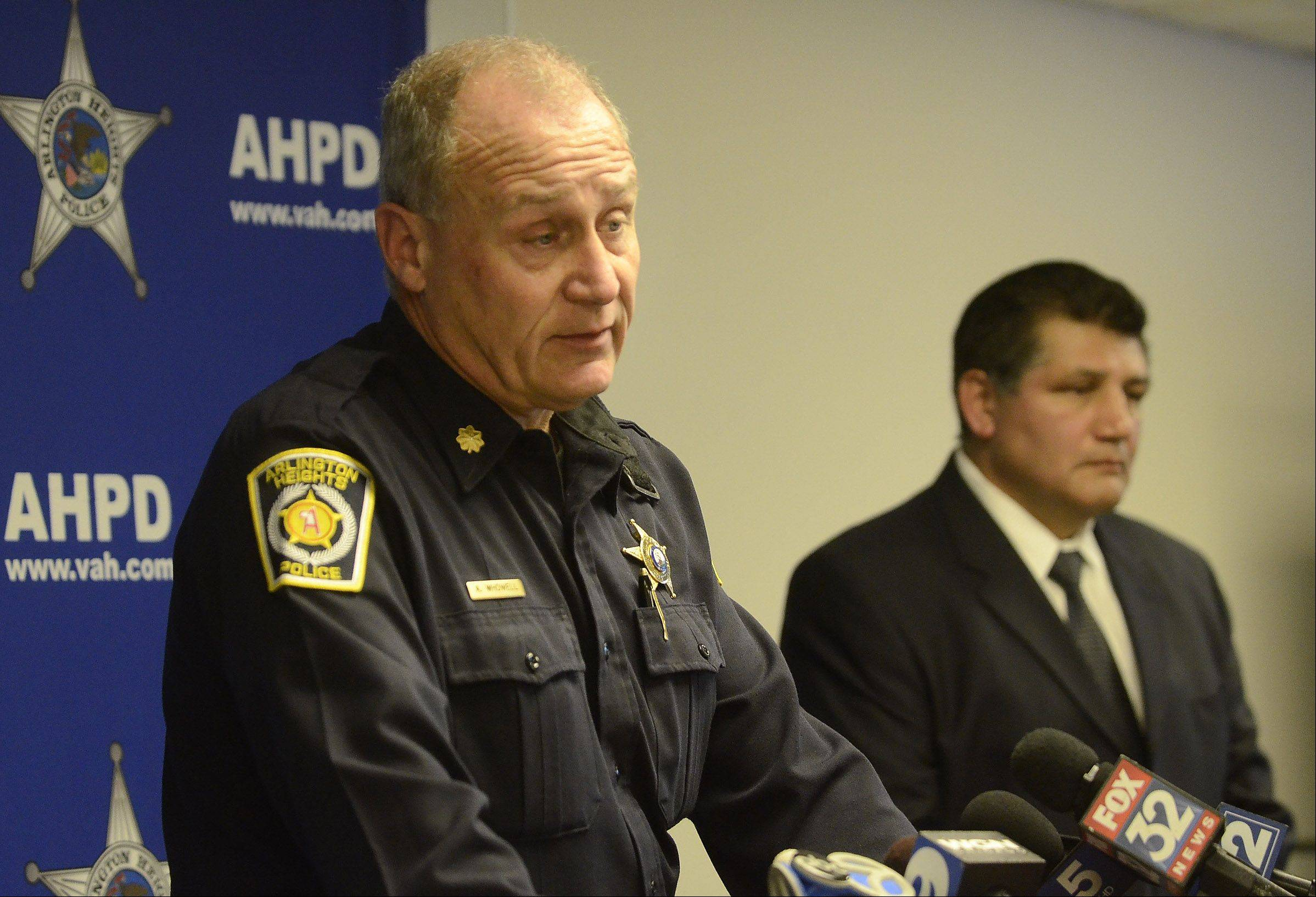 Commanders Andrew T. Whowell, left, and Mike Hernandez of the Arlington Heights Police Department address the media Friday.
