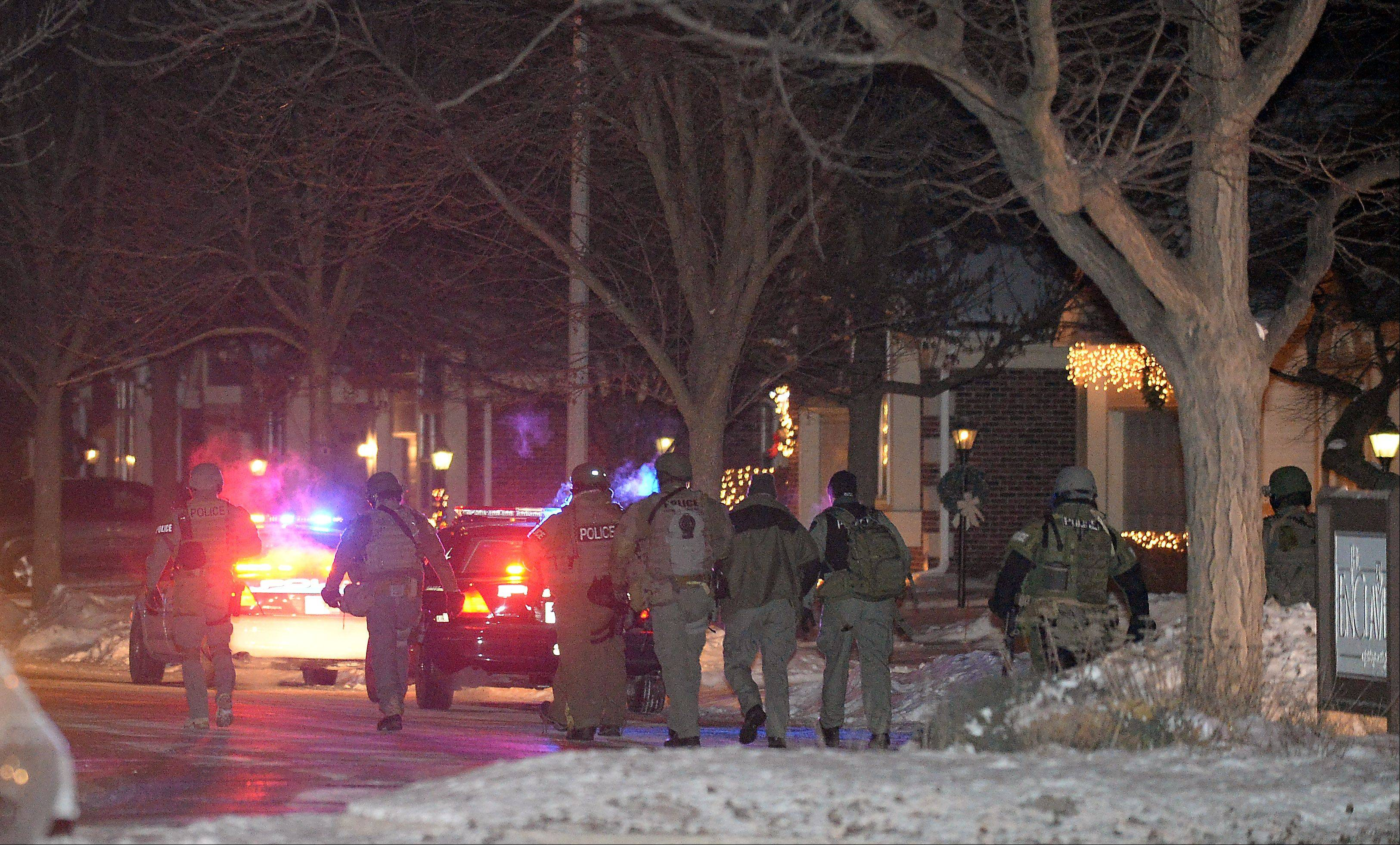 Police and tactical officers respond Thursday nightat the scene where an officer was shot.