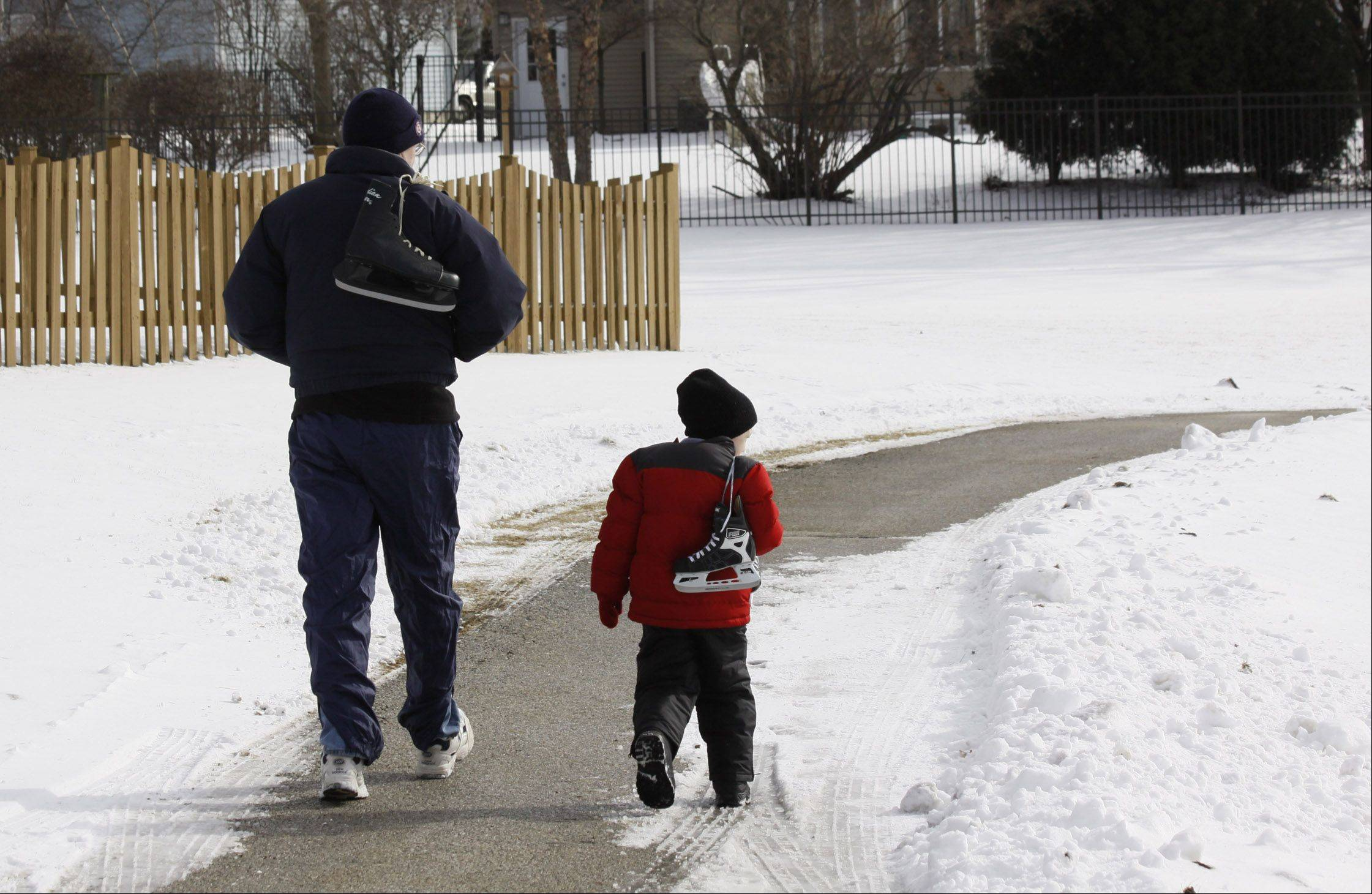Father and son on their way to Ice skating lessons at the ice skating pond in Grayslake in 2010.