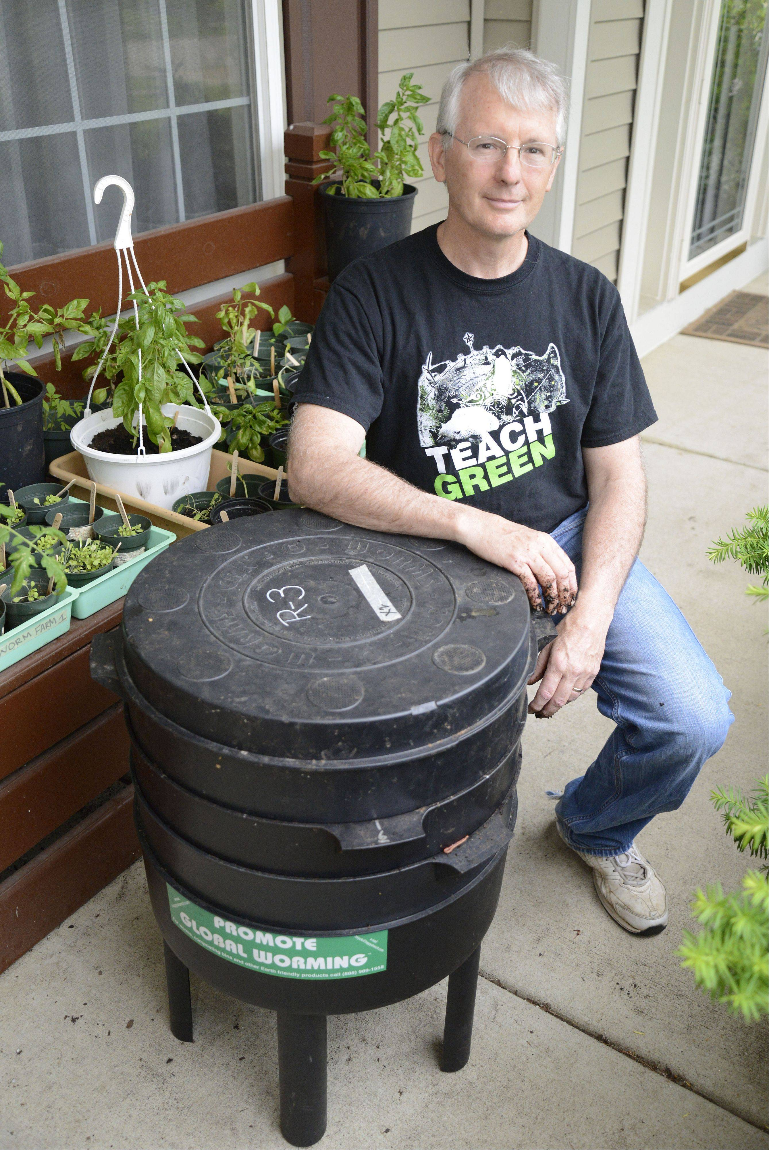 Greg Reiva of Algonquin, a physical science teacher at Streamwood High School, brought the worm farms and hydroponic garden from his classroom home to tend last summer.