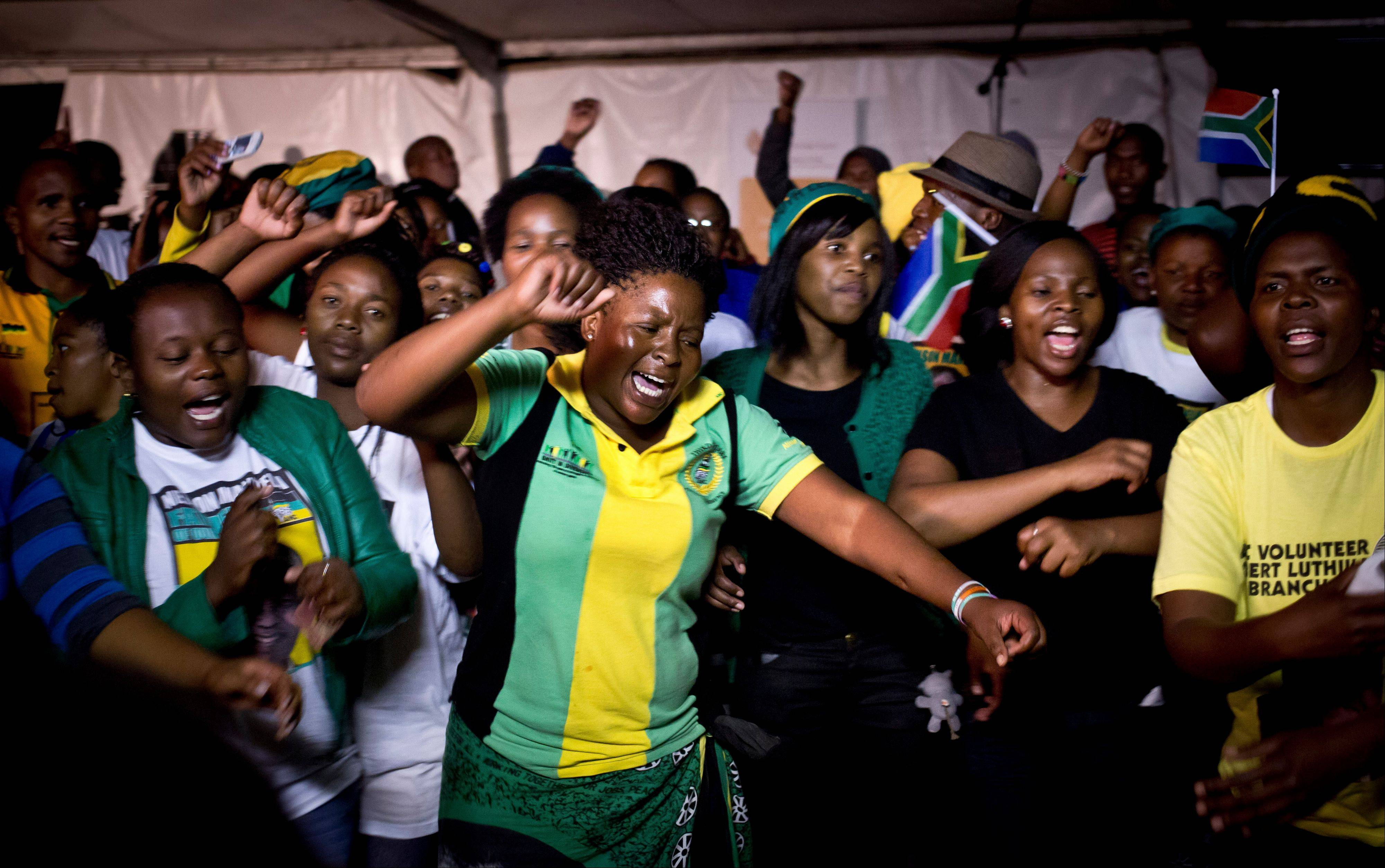 Youth members of the African National Congress dance, pray and sing songs honoring Nelson Mandela, at a nighttime vigil Saturday at the Walter Sisulu University in Mthatha, South Africa.