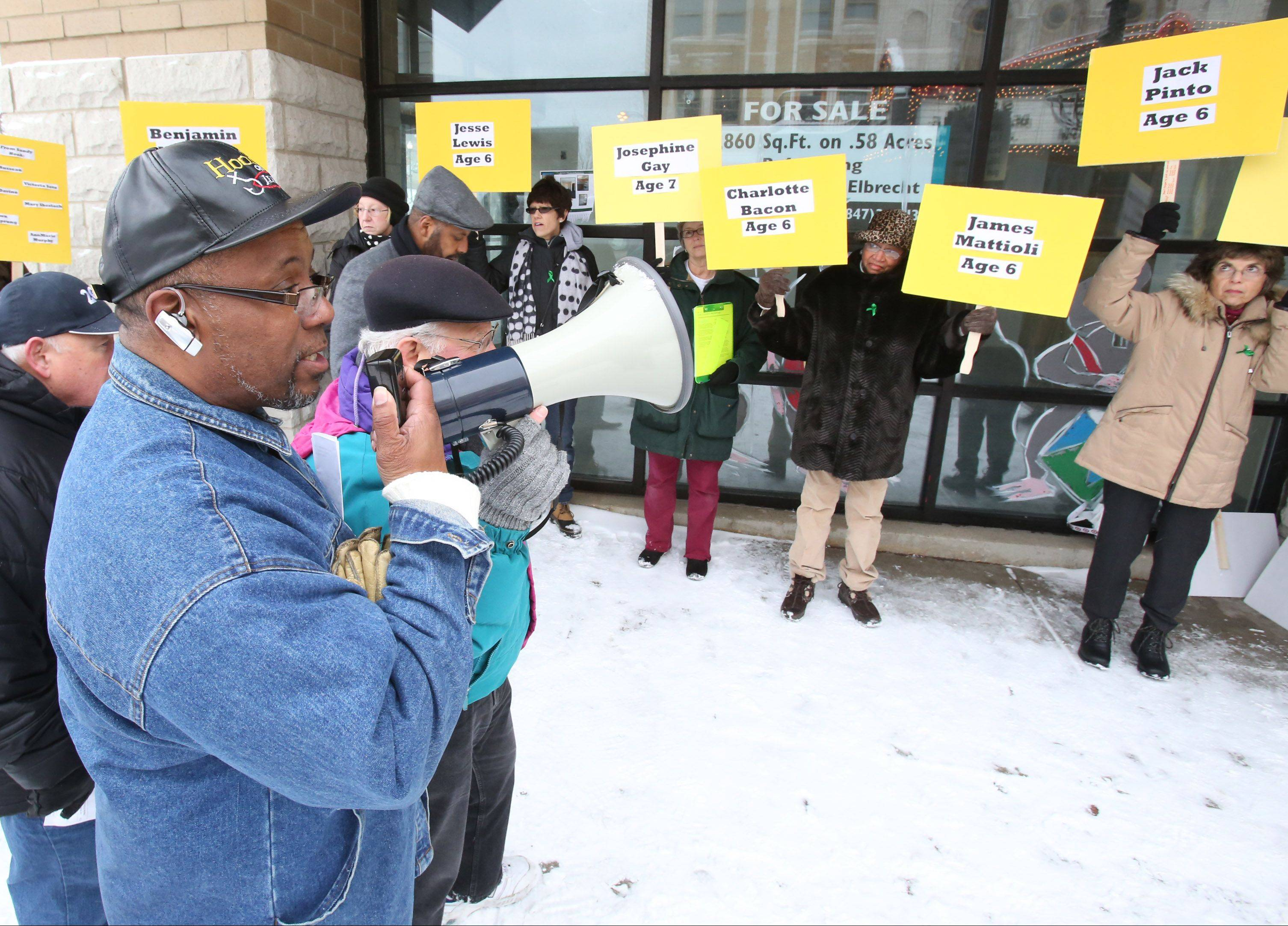 The Rev. Clarence Evans of Mt. Sinai Baptist Church in North Chicago asks people to remember the victims of a shooting that occurred on Dec. 14 last year at a Newtown, Conn., school. The Lake McHenry Chapter of Organizing for Action hosted a remembrance event Saturday in Waukegan.