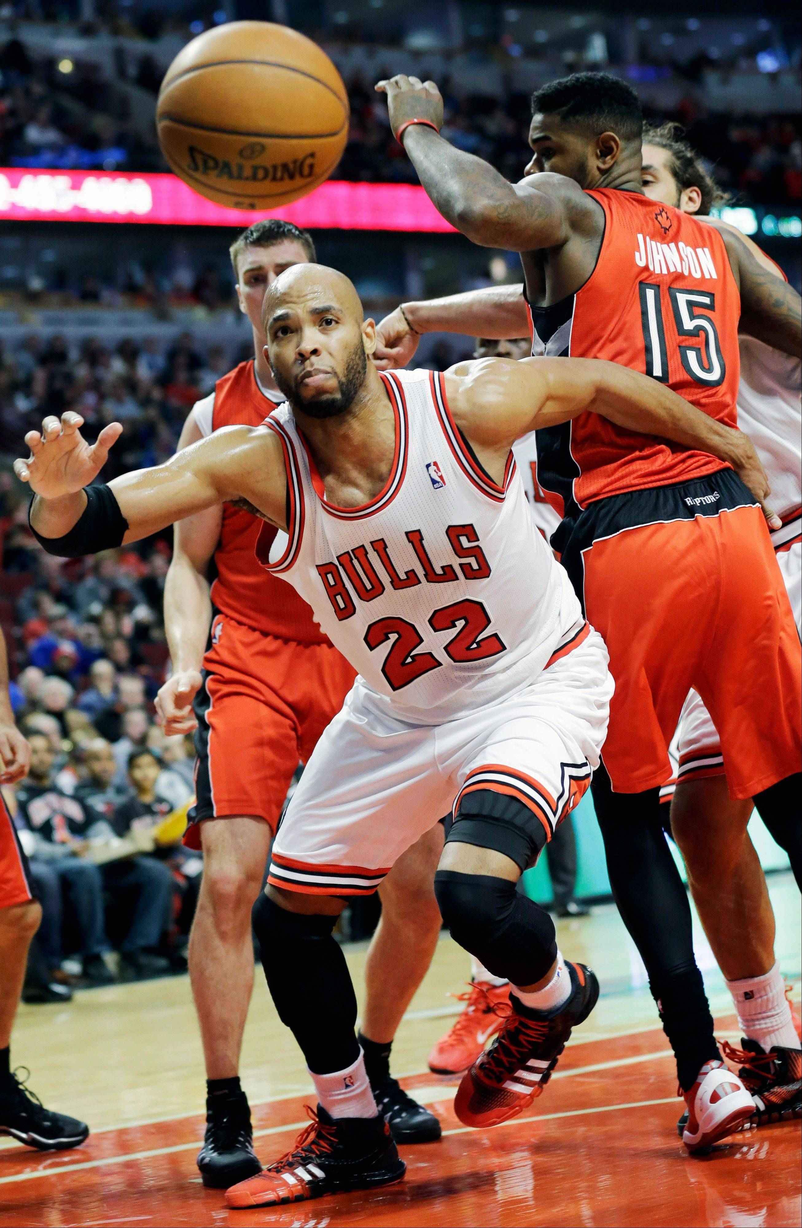 Taj Gibson (22) chases a loose ball during the second half of an NBA basketball game against the Toronto Raptors in Chicago on Saturday, Dec. 14, 2013. The Raptors won 99-77.
