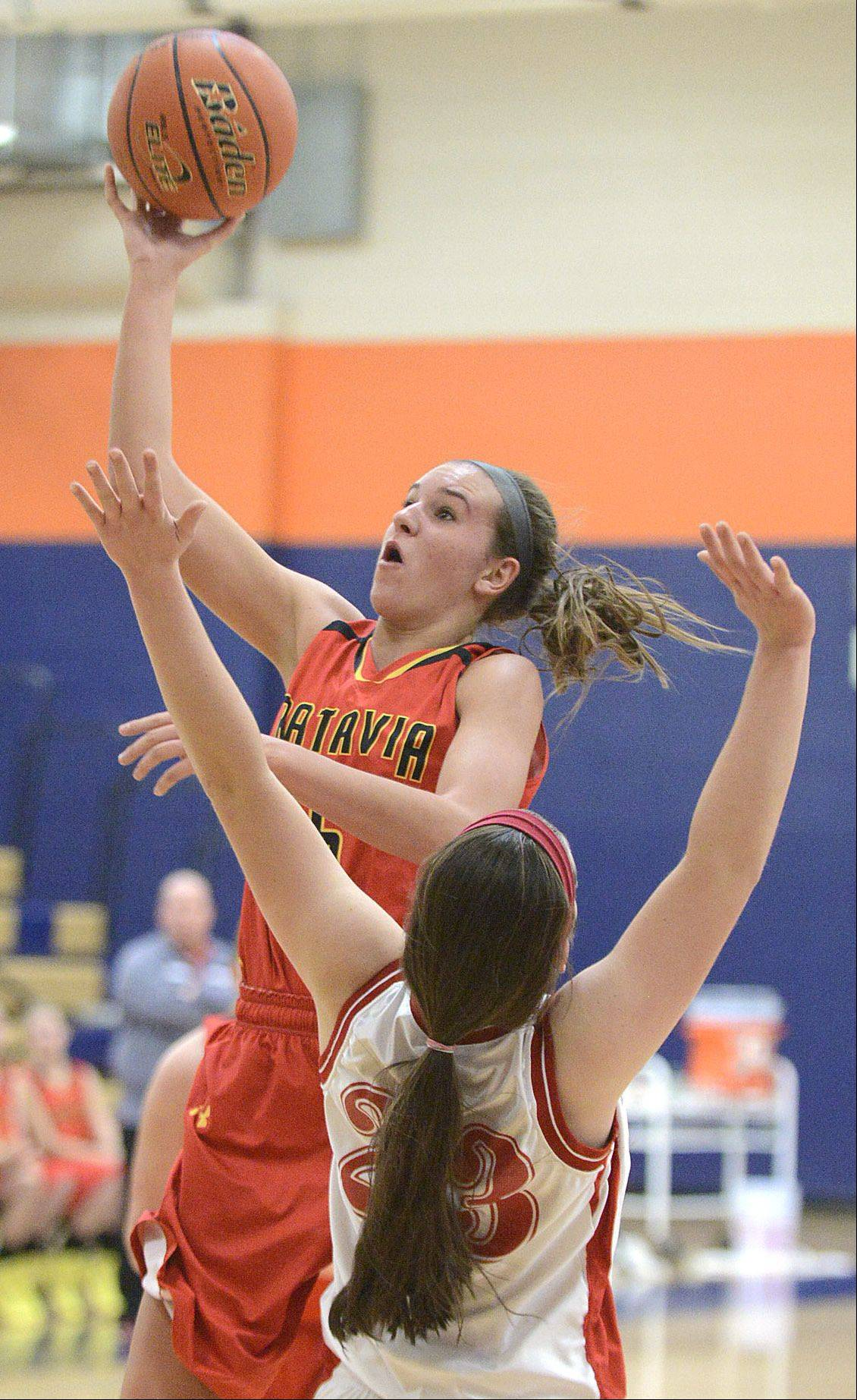 Batavia�s Liza Fruendt shoots over a block by Naperville Central�s Lisa Tassi in the second quarter on Saturday, December 14.