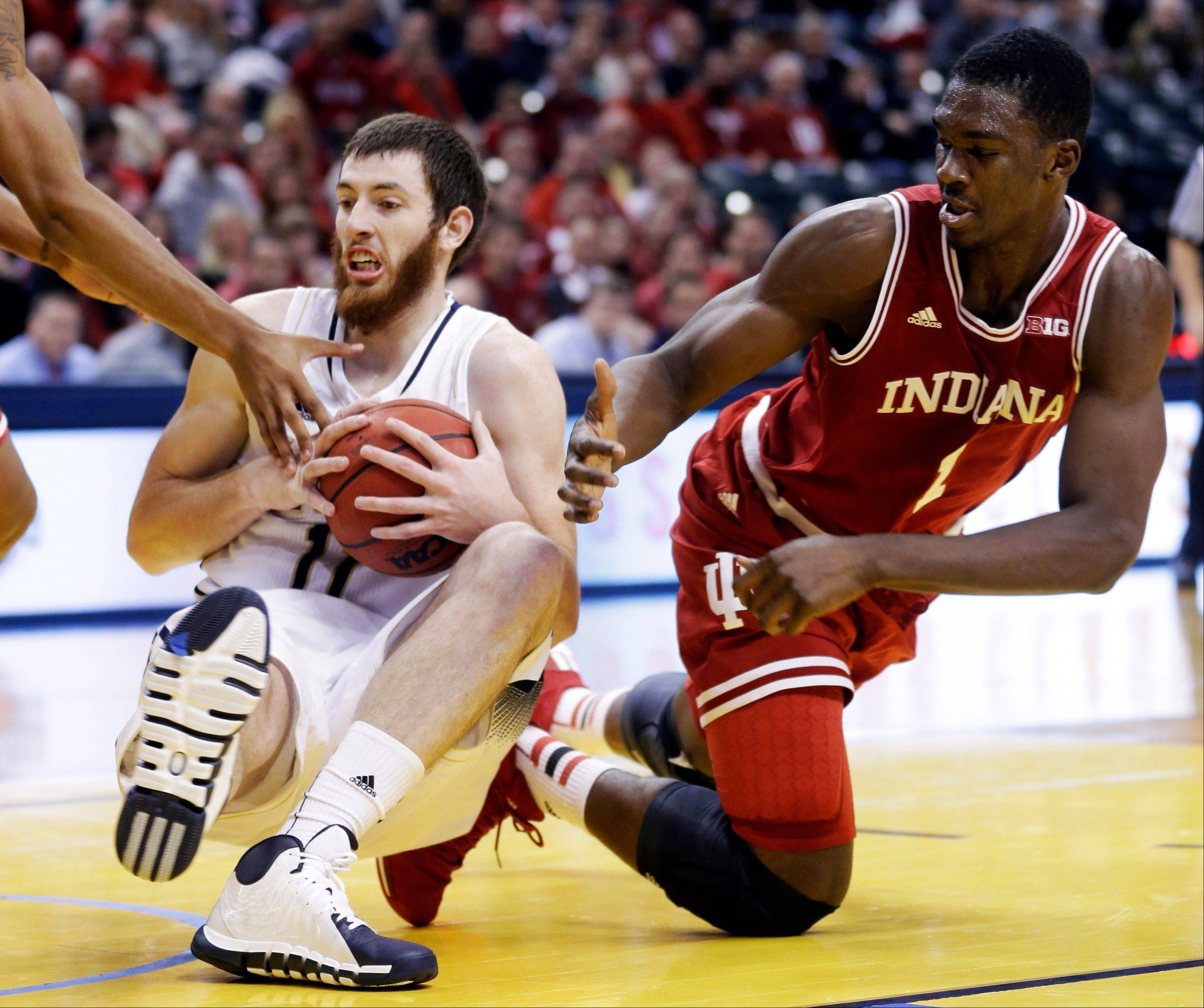 Notre Dame center Garrick Sherman, left, and Indiana forward Noah Vonleh go to the floor for a loose ball in the first half of an NCAA college basketball game in Indianapolis, Saturday, Dec. 14, 2013. (AP Photo/Michael Conroy)