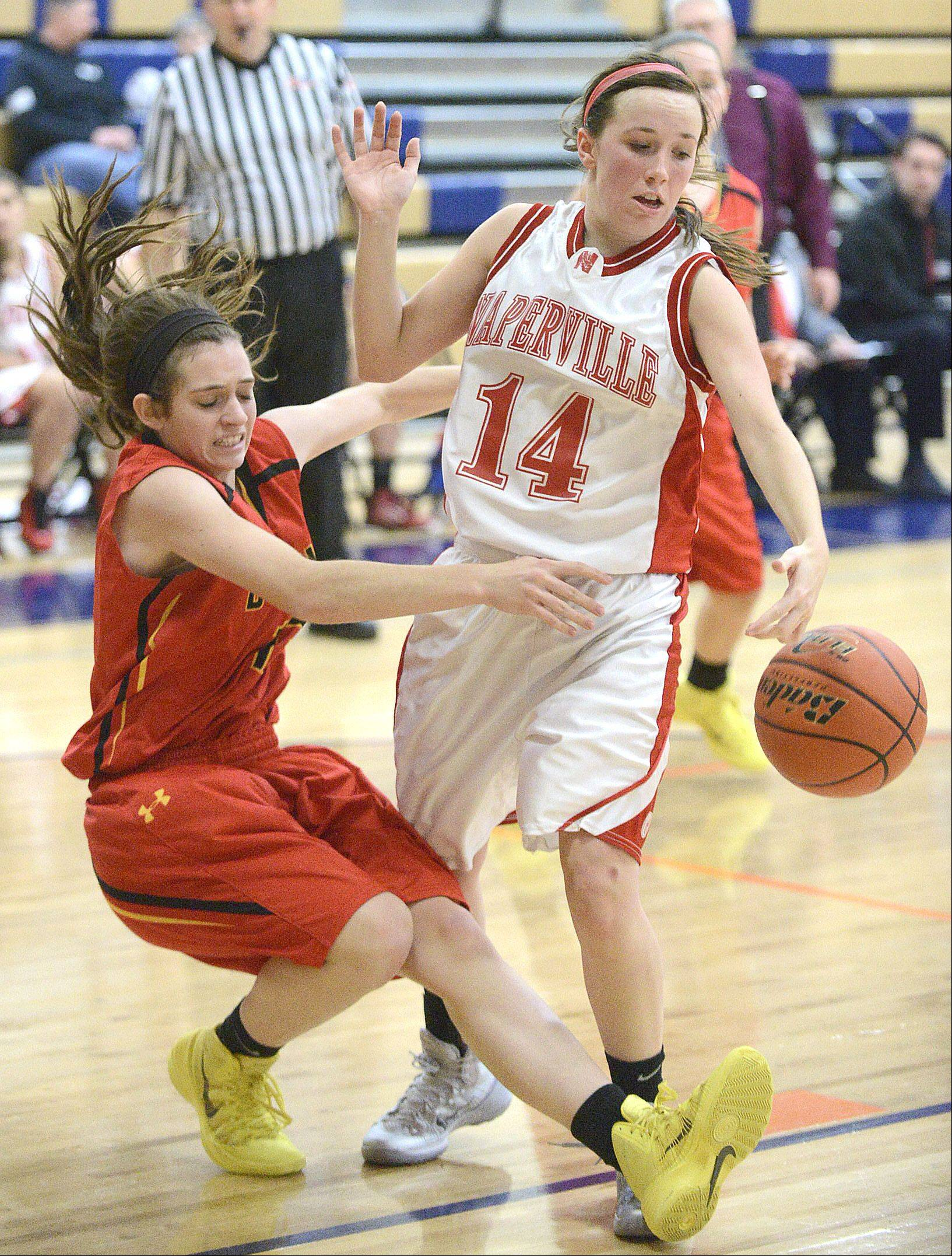 Batavia�s Mackenzie Foster falls to the ground during a pass around Naperville Central�s Emily Kraft in the third quarter on Saturday.