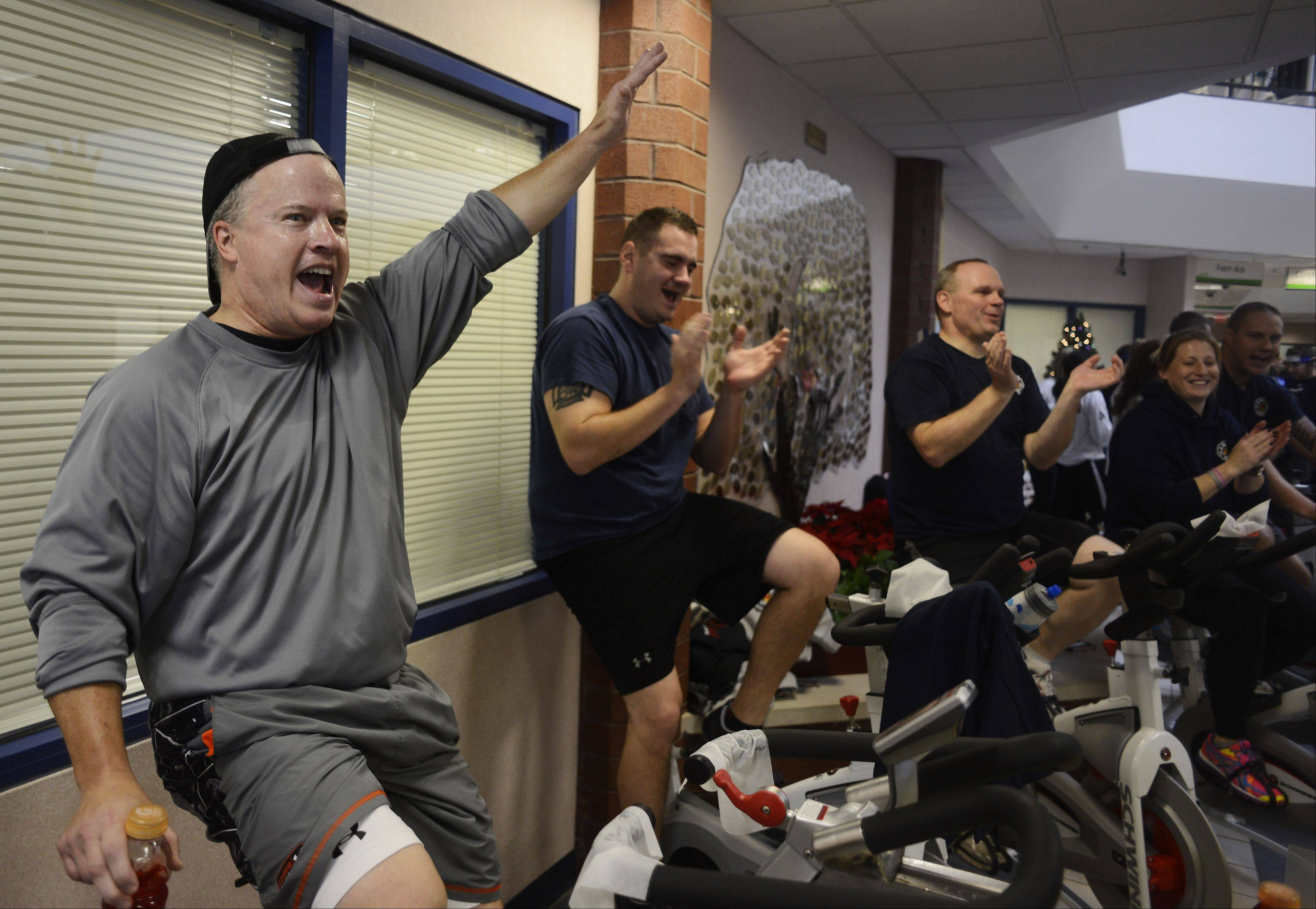 Local business owner Jim O'Malley lets out a cheer after a donor gave the final $10 needed for his group to stop riding Saturday during the Elk Grove Parks Foundation Spin-O-Thon at The Pavilion in Elk Grove Village.
