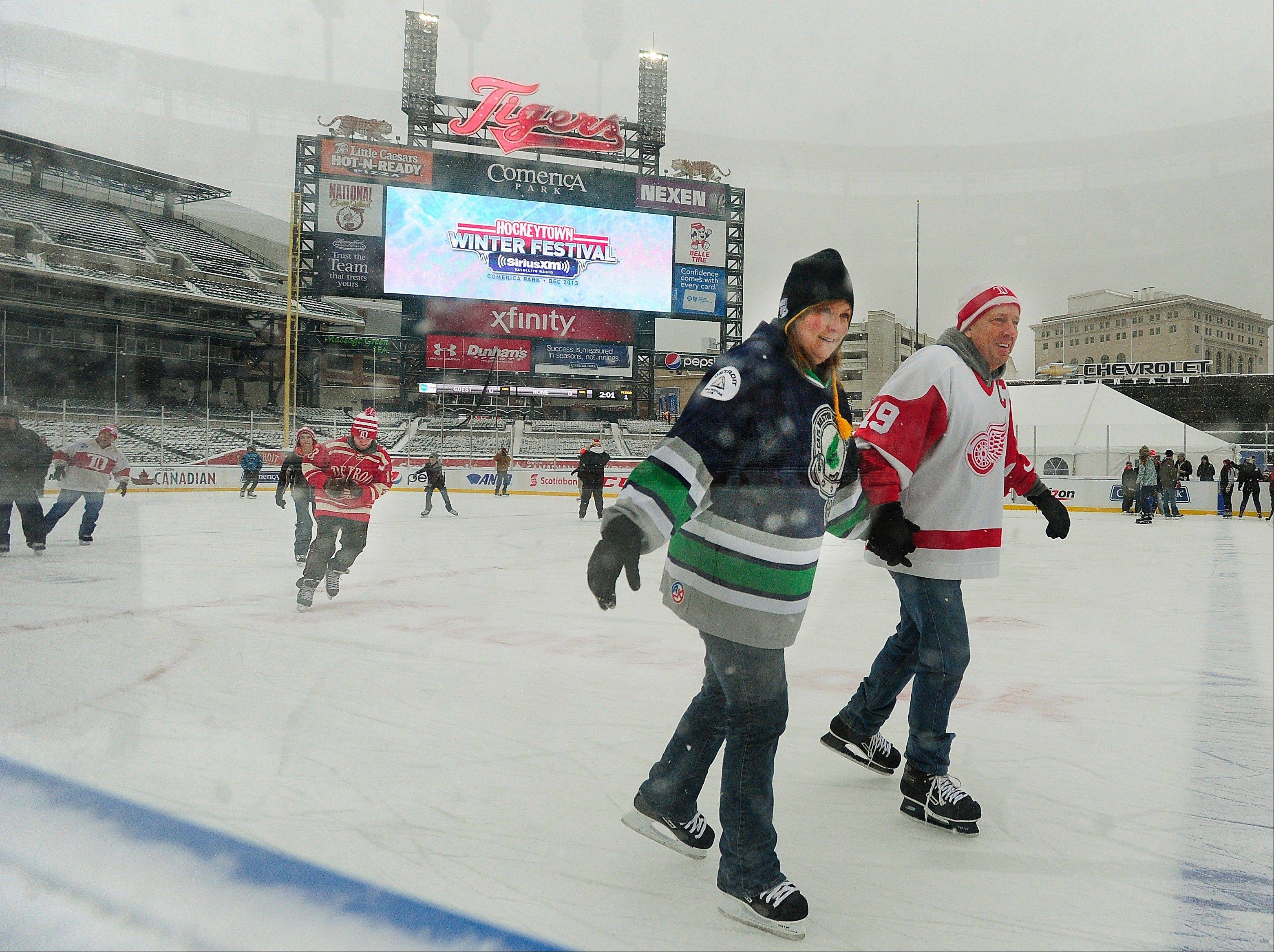 The cold that hovered over much of the country wasn�t all hardship Sunday. From left, Valerie MacIsaac and Joseph Grutza skate at Comerica Park in Detroit.