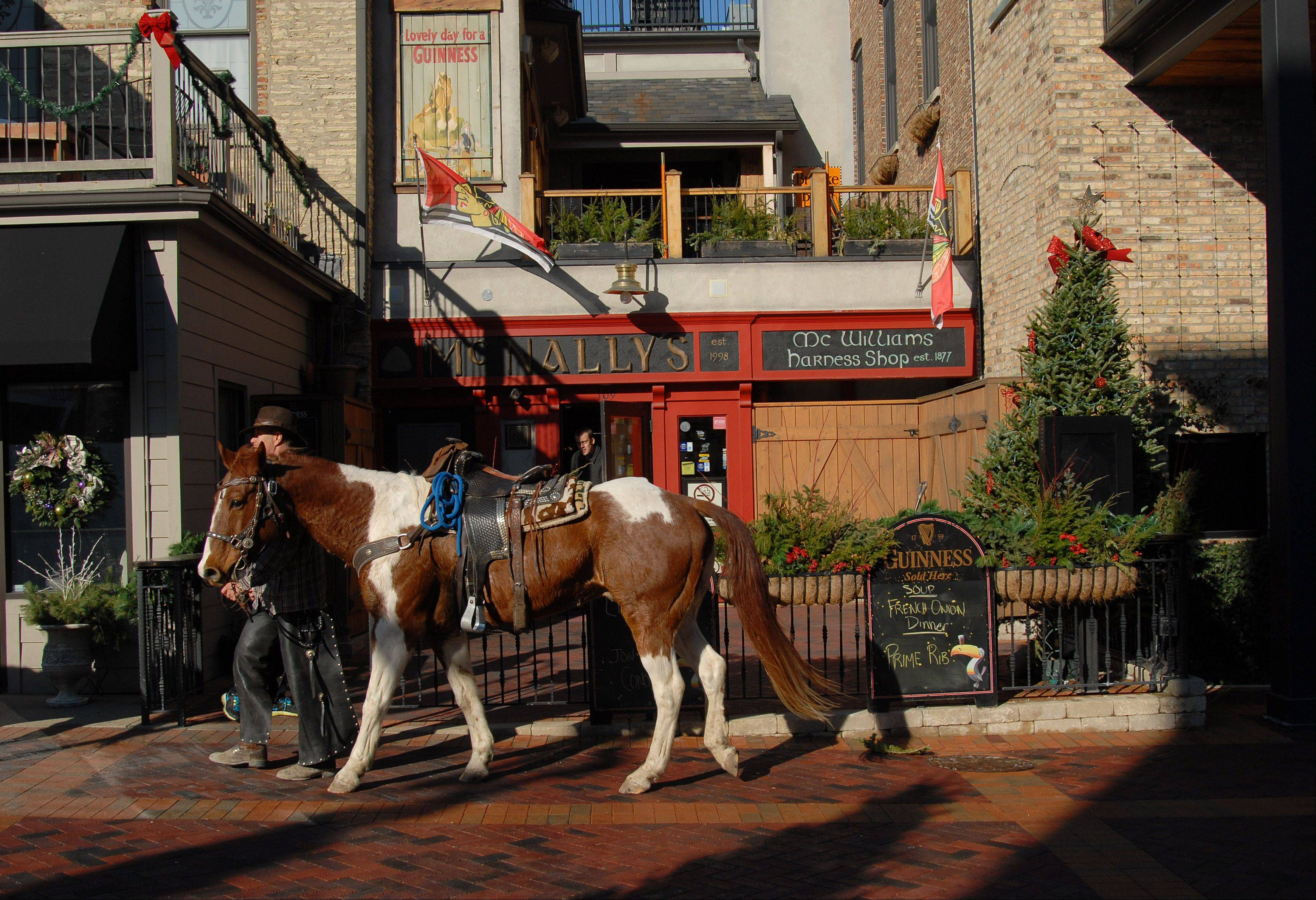 While I was waiting with a crowd of children for Santa Claus to make an appearance in St. Charles, I turned in time to see a couple cowboys walking their horses past a bar. It was a like a flashback to the Old West days. I was able to rattle off a few frames before the back-in-time scene disappeared. It wasn�t until I was editing the photos that I noticed the �McWilliams Harness Shop Est. 1877.� I did a little research and according to the book �St. Charles� by Wynette Edwards, the shop did exist in town and was owned by David McWilliams. This photo was published in the weekly Perspective column in the print edition.