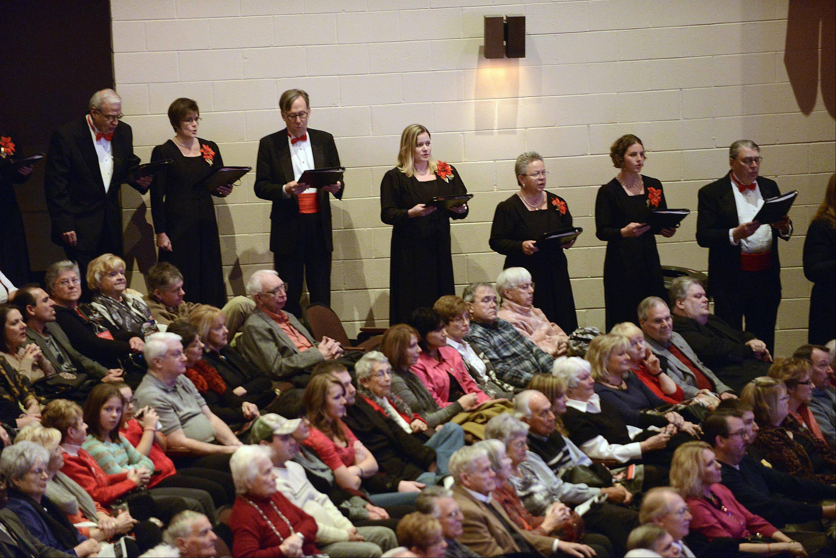 The Elgin Choral Union surrounded the audience Sunday at the start of the Elgin Symphony Orchestra�s Magical Holiday Concert at the Hemmens Cultural Center in Elgin. The concert also featured the Elgin Children�s Chorus, Midwest Dance Collective and soprano Elizabeth Norman.