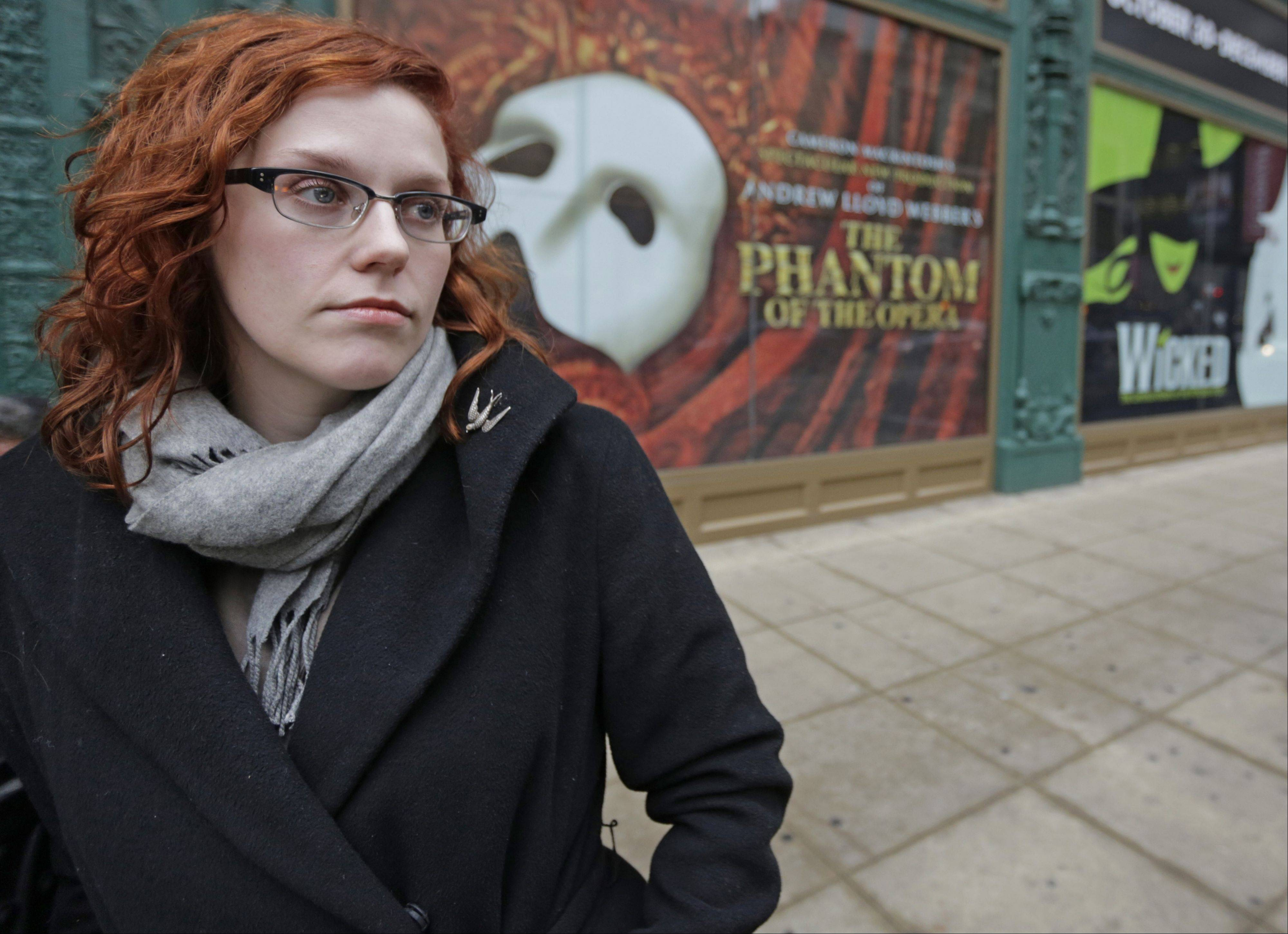 Actor Adrienne Matzen poses in Chicago�s theater district. Matzen, 29, who has been mostly uninsured since she turned 21, is now looking for a low monthly premium insurance plan on the federal website.