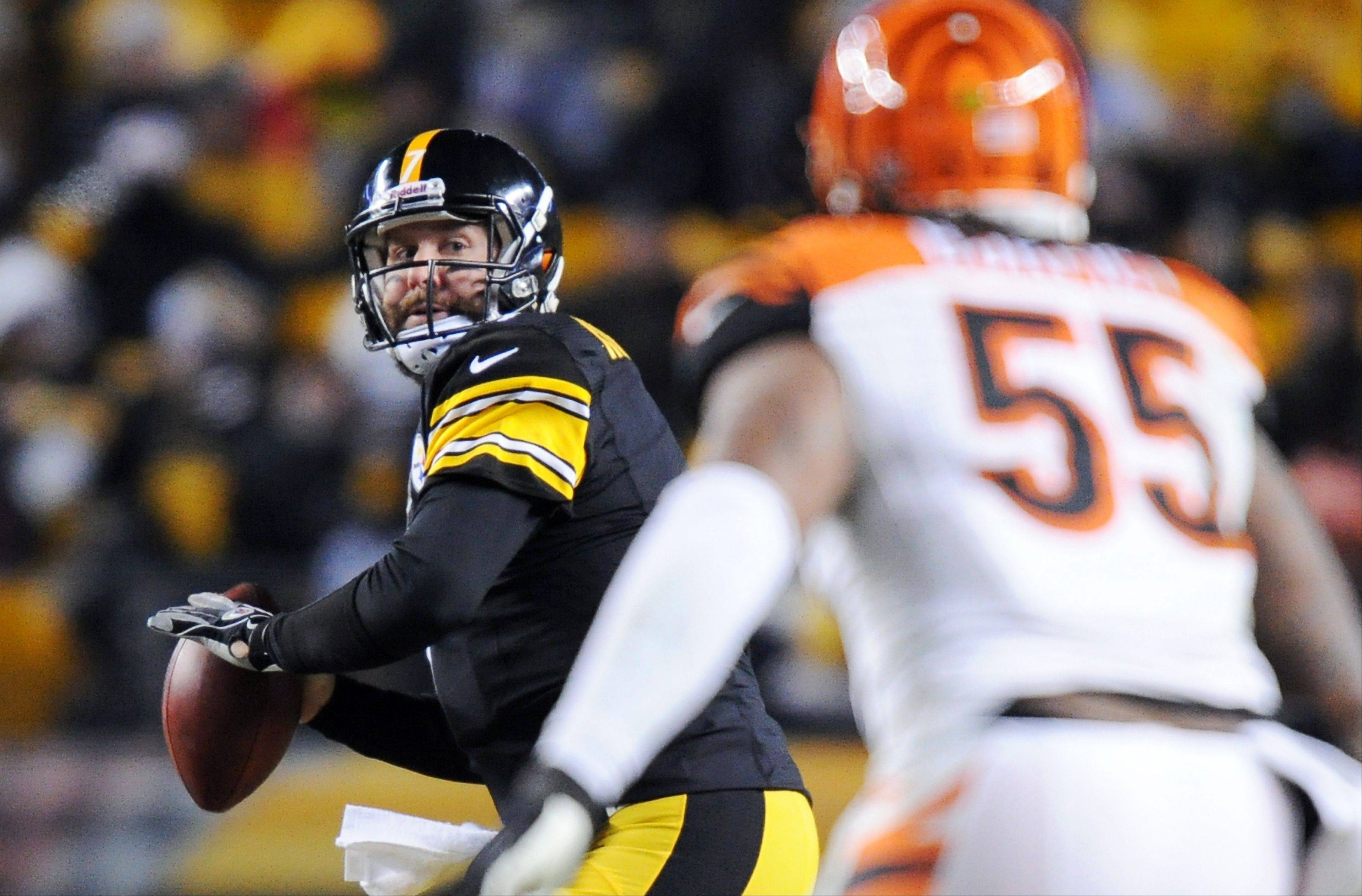 Pittsburgh Steelers quarterback Ben Roethlisberger, left, looks to pass as Cincinnati Bengals outside linebacker Vontaze Burfict (55) defends in the third quarter an NFL football game on Sunday, Dec. 15, 2013, in Pittsburgh.