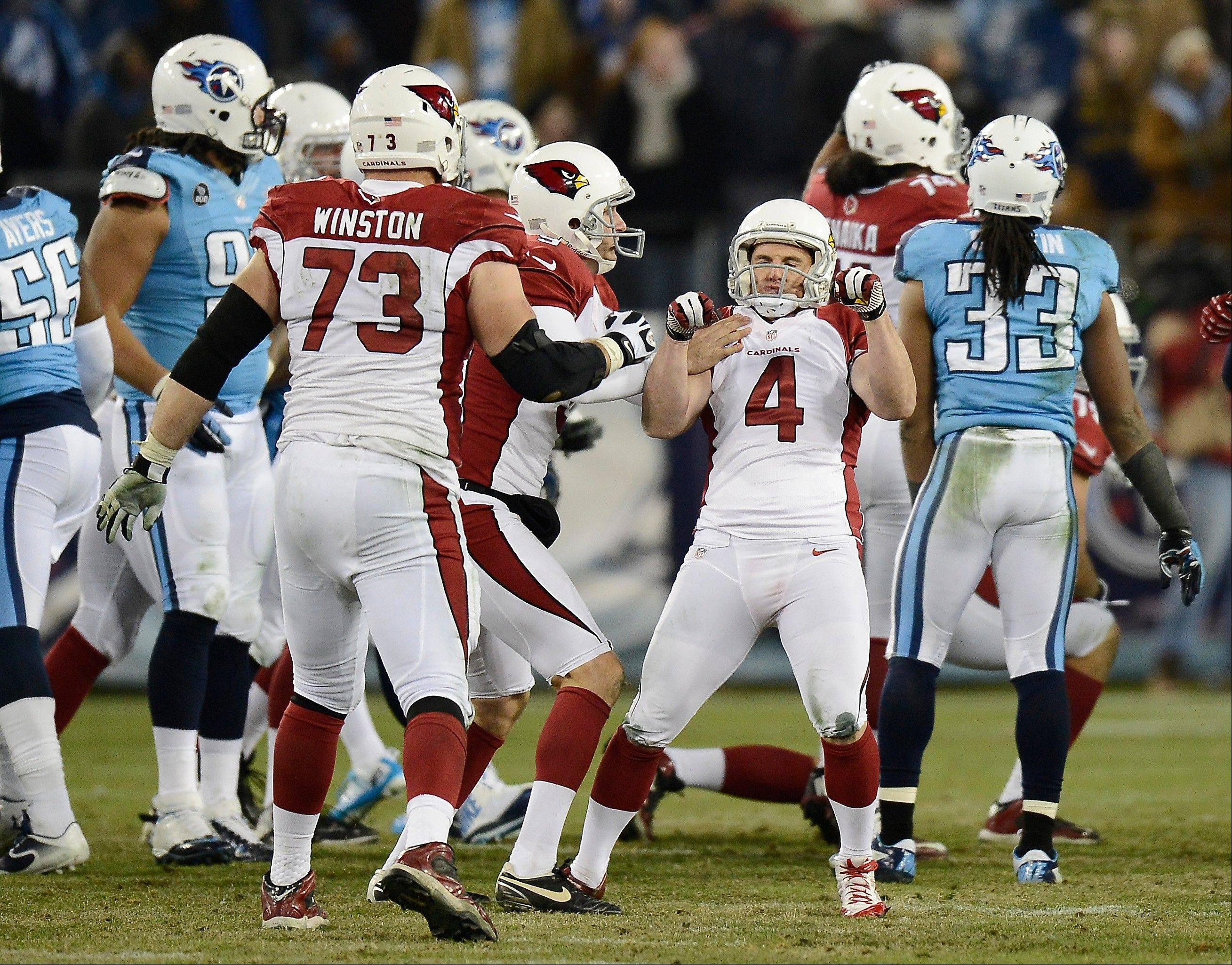 Arizona Cardinals kicker Jay Feely (4) celebrates after kicking a 41-yard field goal in overtime against the Tennessee Titans to give the Cardinals a 37-34 win in an NFL football game Sunday, Dec. 15, 2013, in Nashville, Tenn.