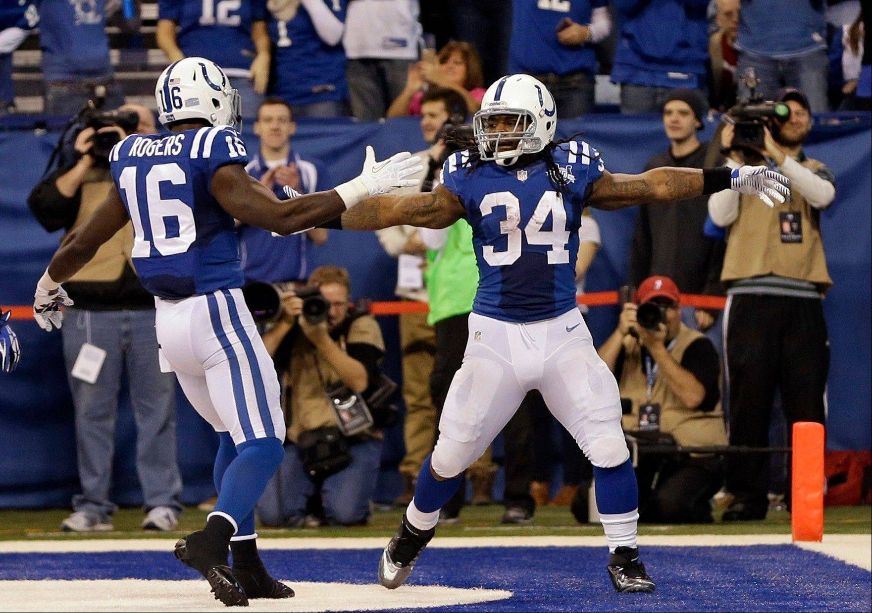 Indianapolis Colts running back Trent Richardson, right, celebrates a touchdown against the Houston Texans with wide receiver Da�Rick Rogers during the first half of an NFL football game in Indianapolis, Sunday, Dec. 15, 2013.