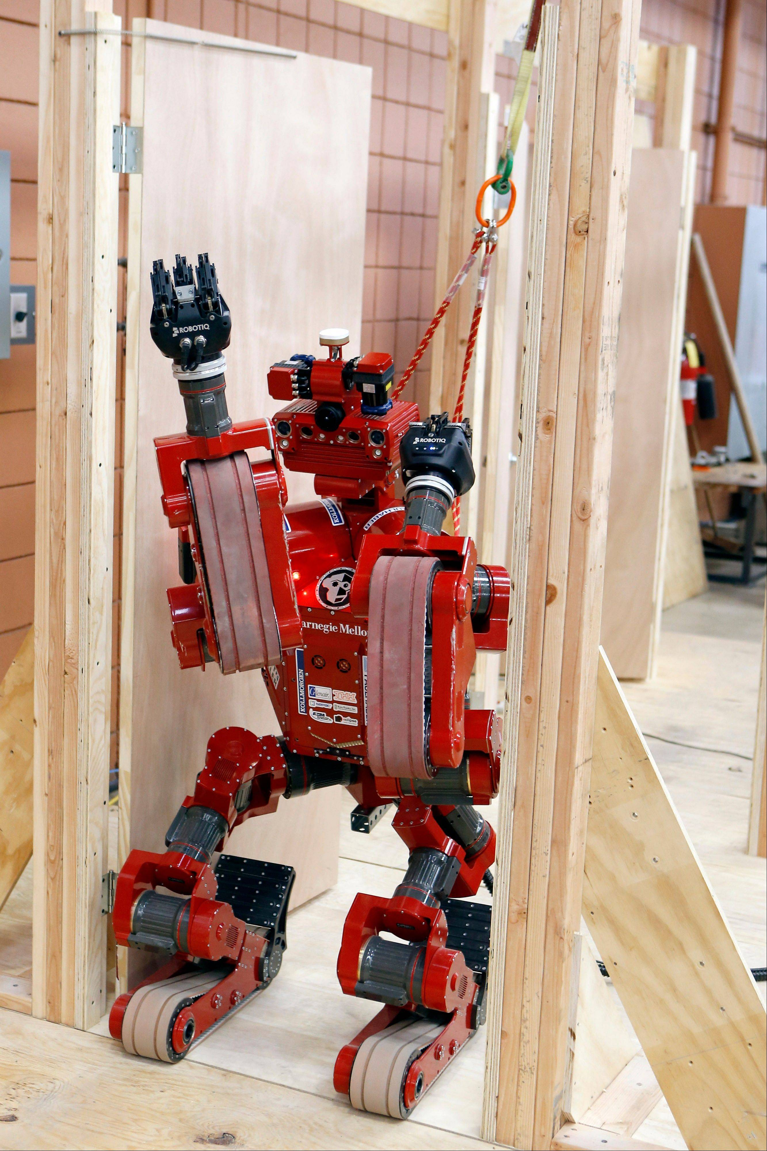 The CMU Highly Intelligent Mobile Platform robot, known as CHIMP, performs a set of doorway tests during a preparation run at the National Robotics Engineering Center in Pittsburgh. Carnegie Mellon researchers are testing the new search-and-rescue robot that will compete in the U.S. Defense Department's upcoming national robotics competition in Florida. Competitors from other schools and companies will be vying for a $2 million U.S. Defense Department prize.