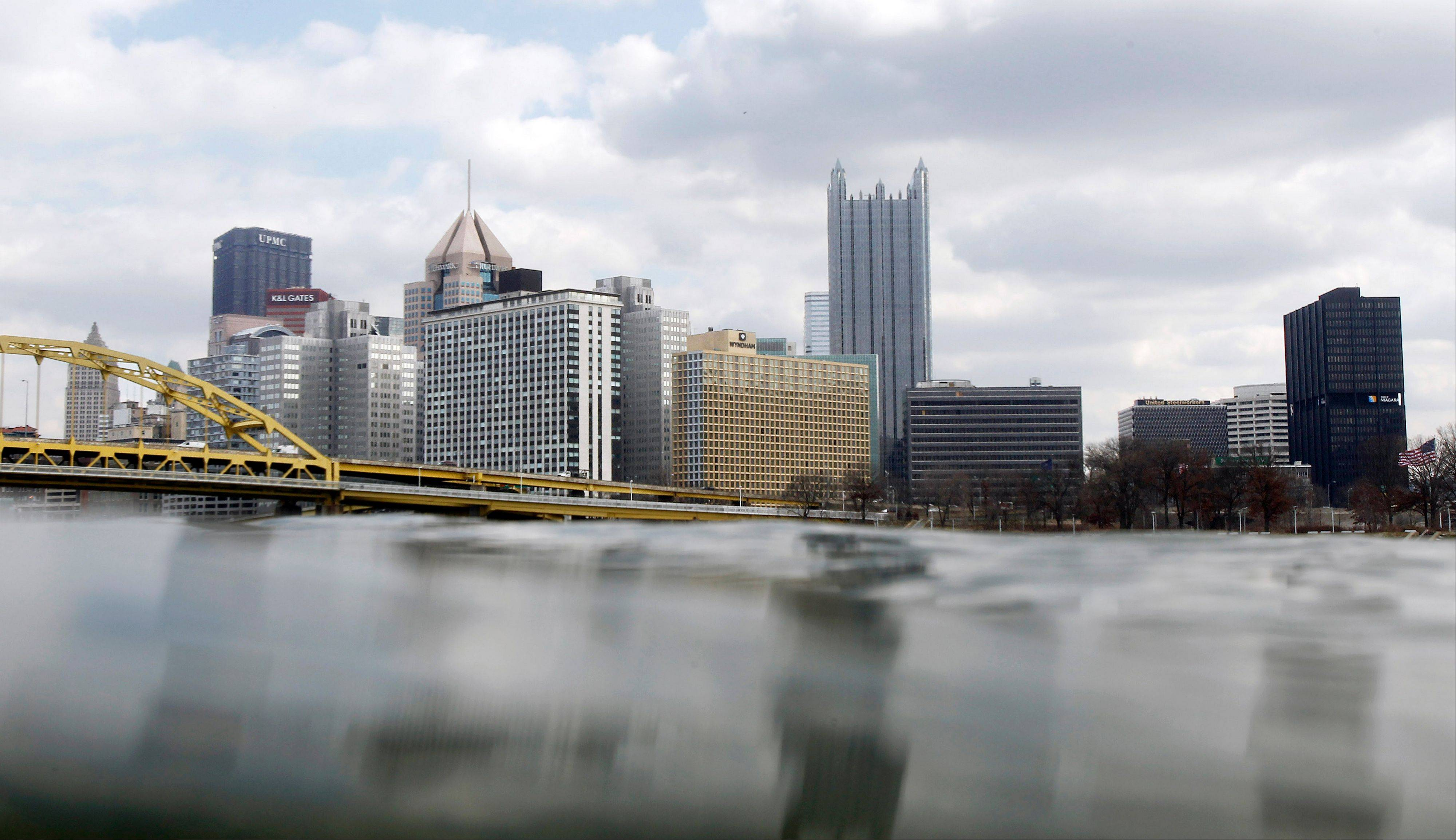 The Pittsburgh skyline rises above the waters of the Ohio River, which starts at the confluence of the Monongahela and Allegheny Rivers. The U.S. Coast Guard wants to allow barges filled with fracking wastewater to ply the nation's rivers on their way toward disposal, an idea that's raising alarm among environmentalists but could also provide long-elusive information on what exactly the toxic brews contain.