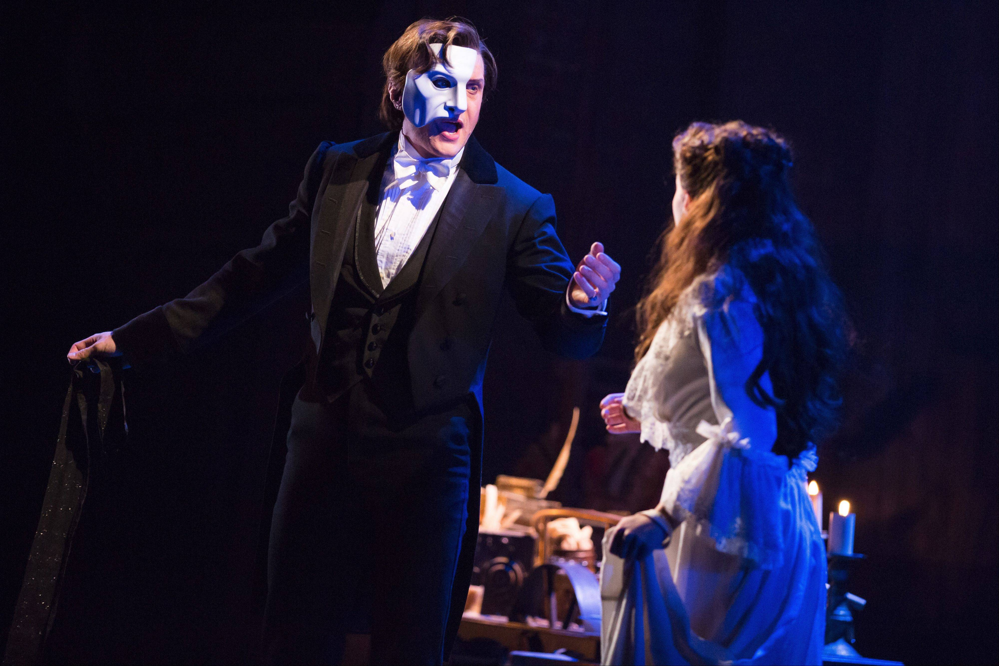 "Mark Campbell portrays the phantom and Julia Udine stars as Christine in the re-imagined production of ""The Phantom of the Opera."" The Andrew Lloyd Webber musical plays Chicago's Cadillac Palace Theatre starting Jan. 9."