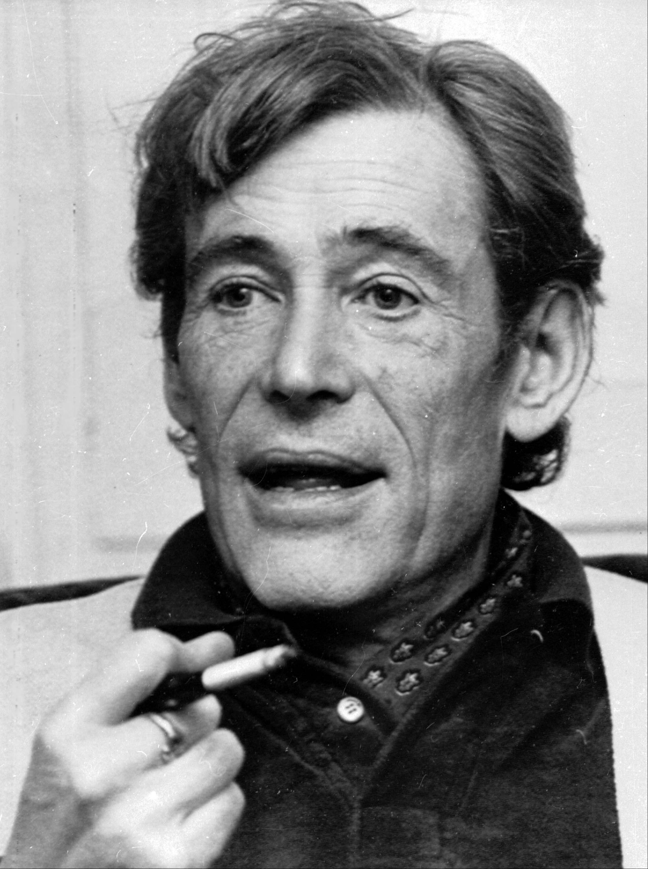 Actor Peter O'Toole smokes during an interview at his London home. O'Toole, the charismatic actor who achieved instant stardom as Lawrence of Arabia and was nominated eight times for an Academy Award, has died. He was 81.