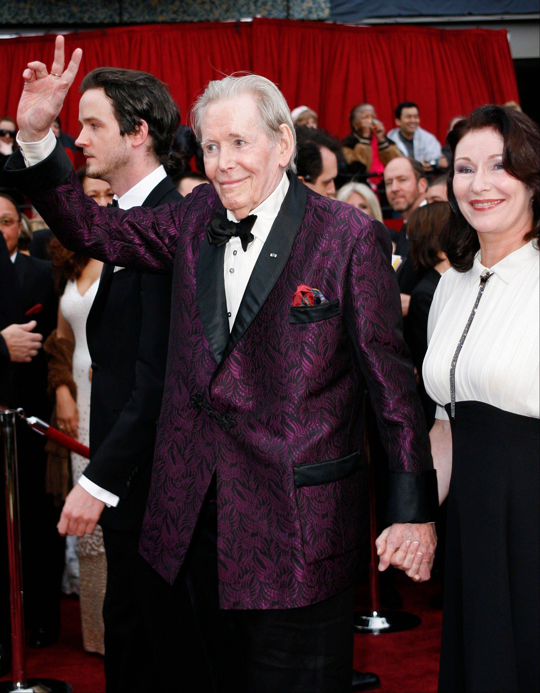 "Actor Peter O'Toole, left, nominated for an Oscar for best actor in a leading role for his work in ""Venus,"" arrives with his daughter Kate for the 79th Academy Awards in Los Angeles."