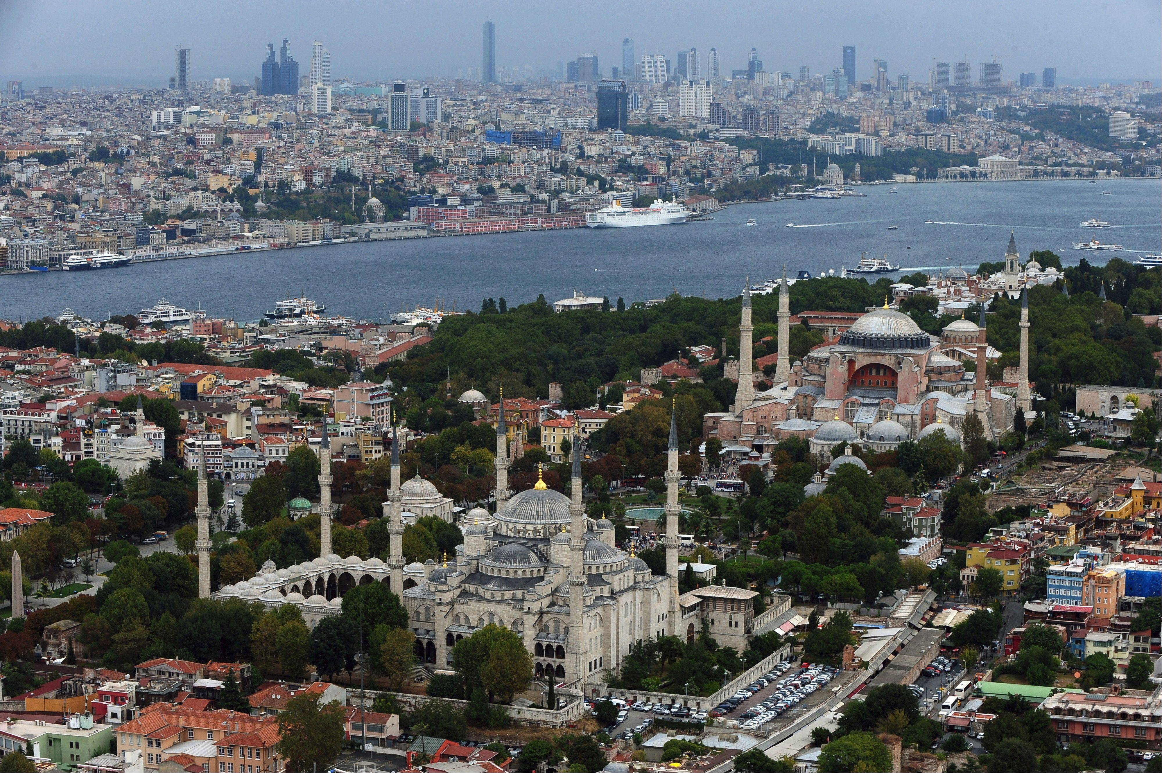 The Sultan Ahmed Mosque, better known as the Blue Mosque, left, and Hagia Sophia in the historic Sultanahmet district in Istanbul, Turkey, are popular tourist destinations.