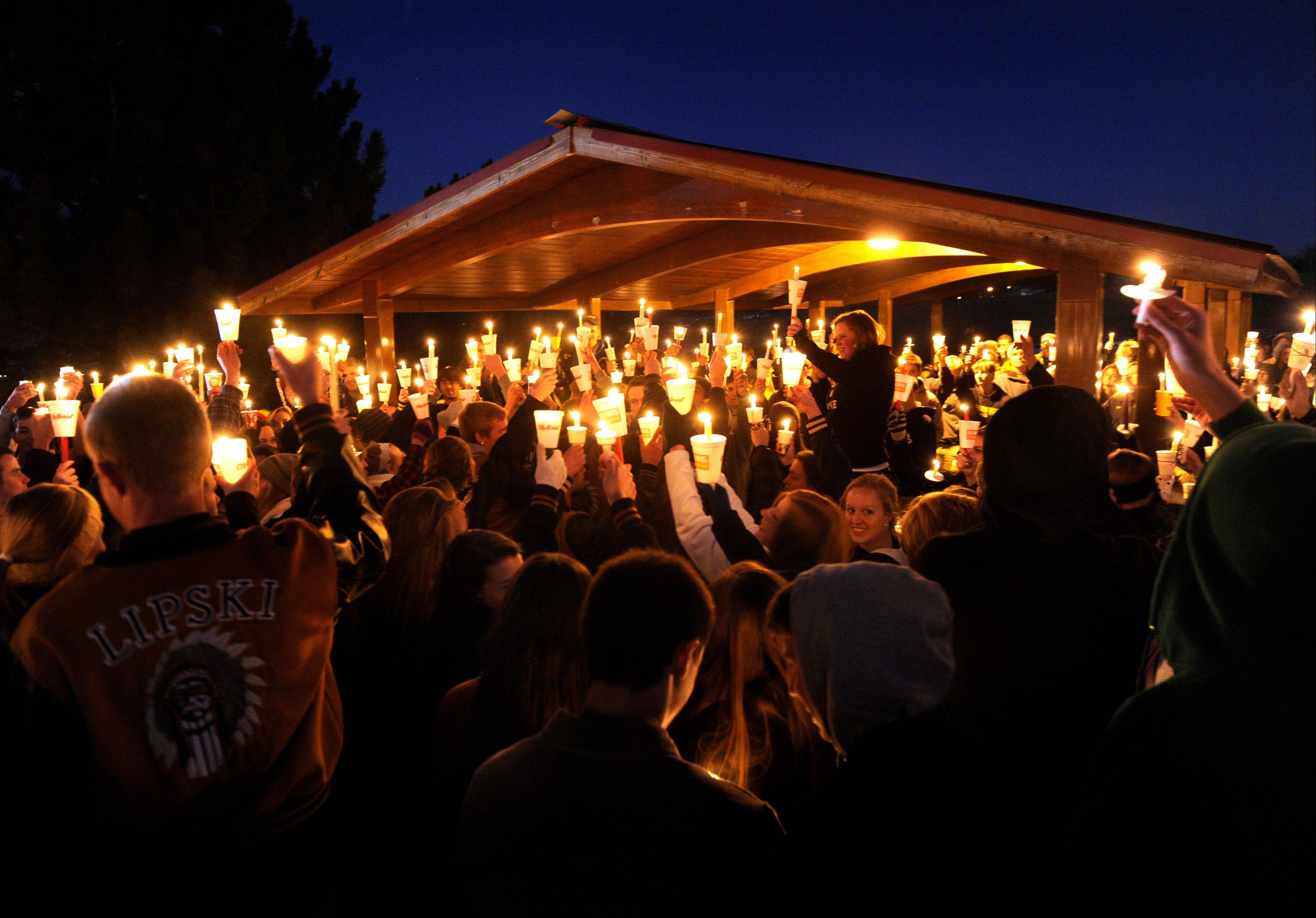 Hundreds of Arapahoe High School students gathered for a candlelight vigil Saturday night to share their prayers for Claire Davis who was shot inside the school Friday. The vigil was held at Arapaho Park in Centennial, not far from the school.