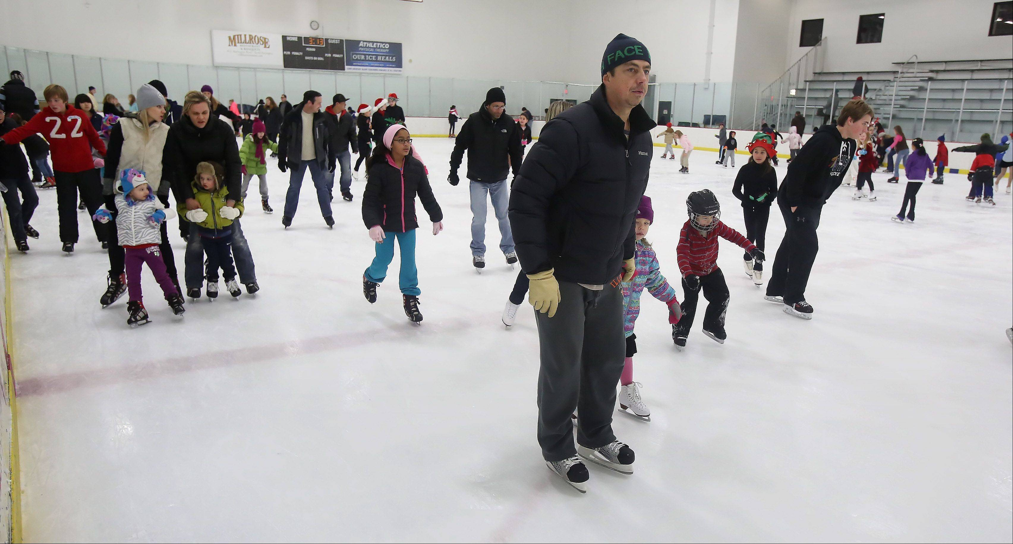 Over 200 people took to the ice Sunday during Skate with Santa at Triphahn Ice Arena in Hoffman Estates. Families enjoyed open skating with Mr. and Mrs. Claus as well as Frosty, the Snowman.